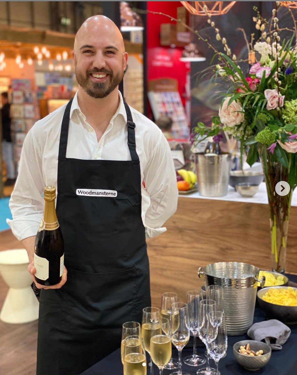 Above: Seth Woodmansterne, deputy md of Woodmansterne on the company's stand at Spring Fair ready to pour out the fizz for its retail customers at the end of the day.