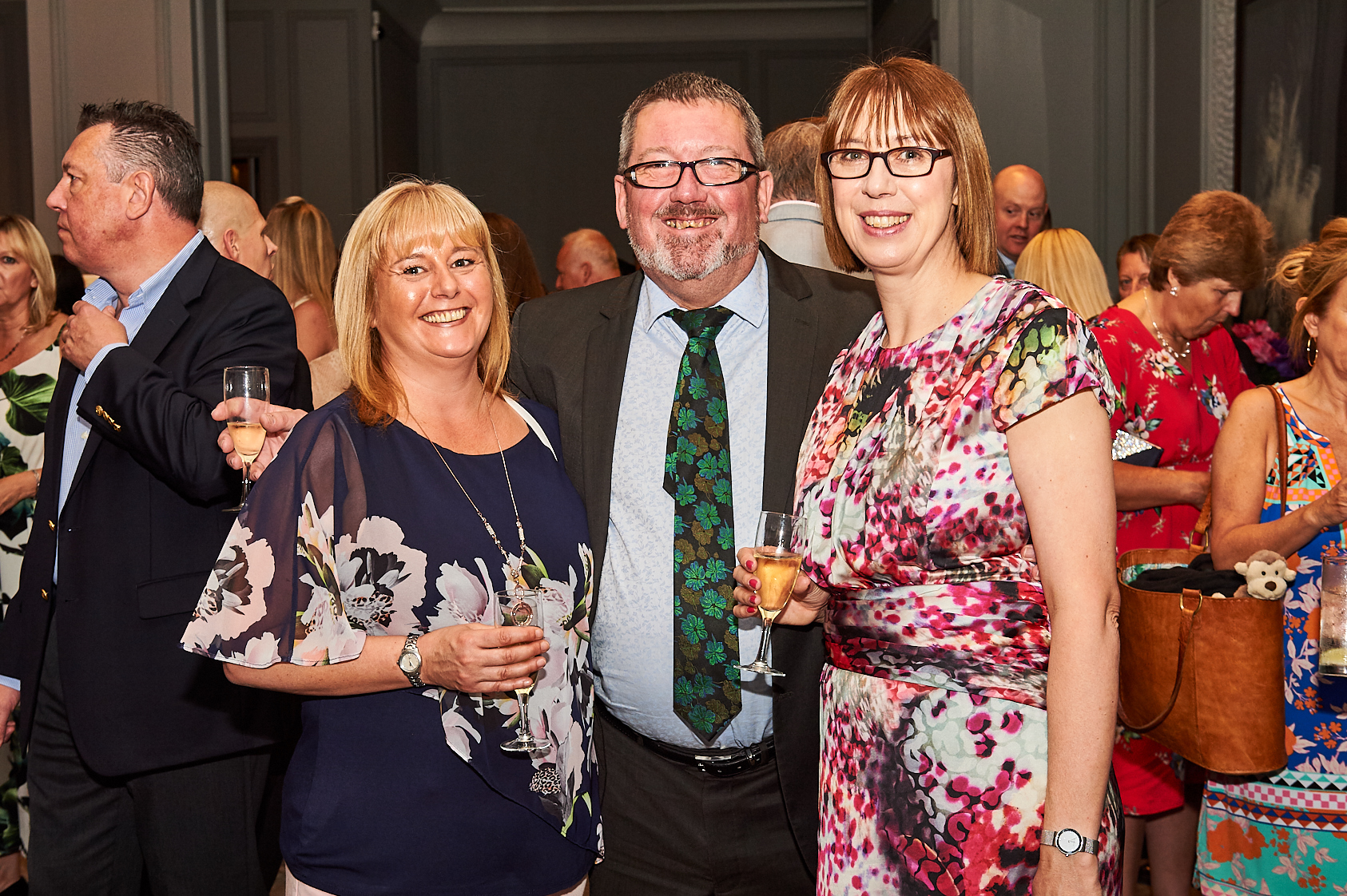 Above: Nigel and (right) Karen Hamilton-Evans with Amanda Pedley from the Post Office retail team at The Retas last July.