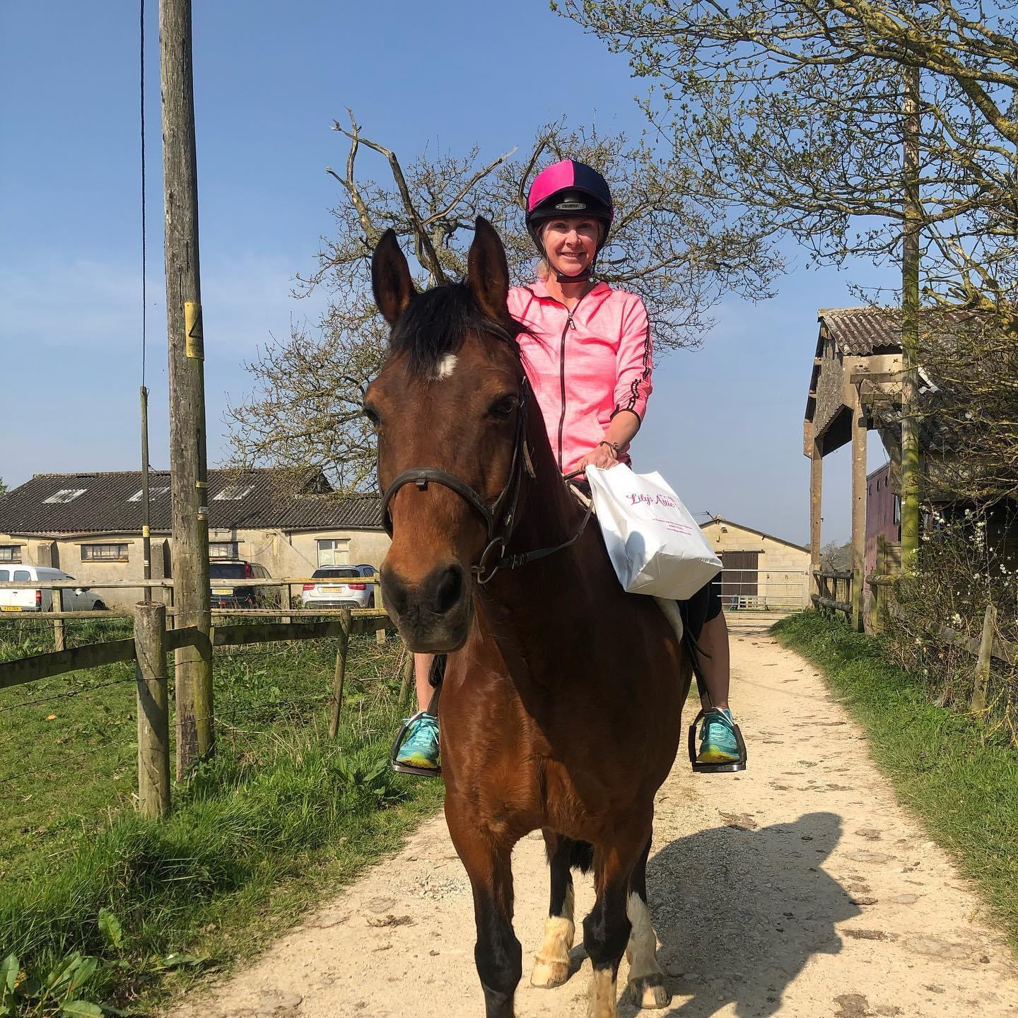 Above: Tamsin Butler, owner of Lily's Attic in Witney, is pictured on her horse Boswell, delivering orders to her customers.