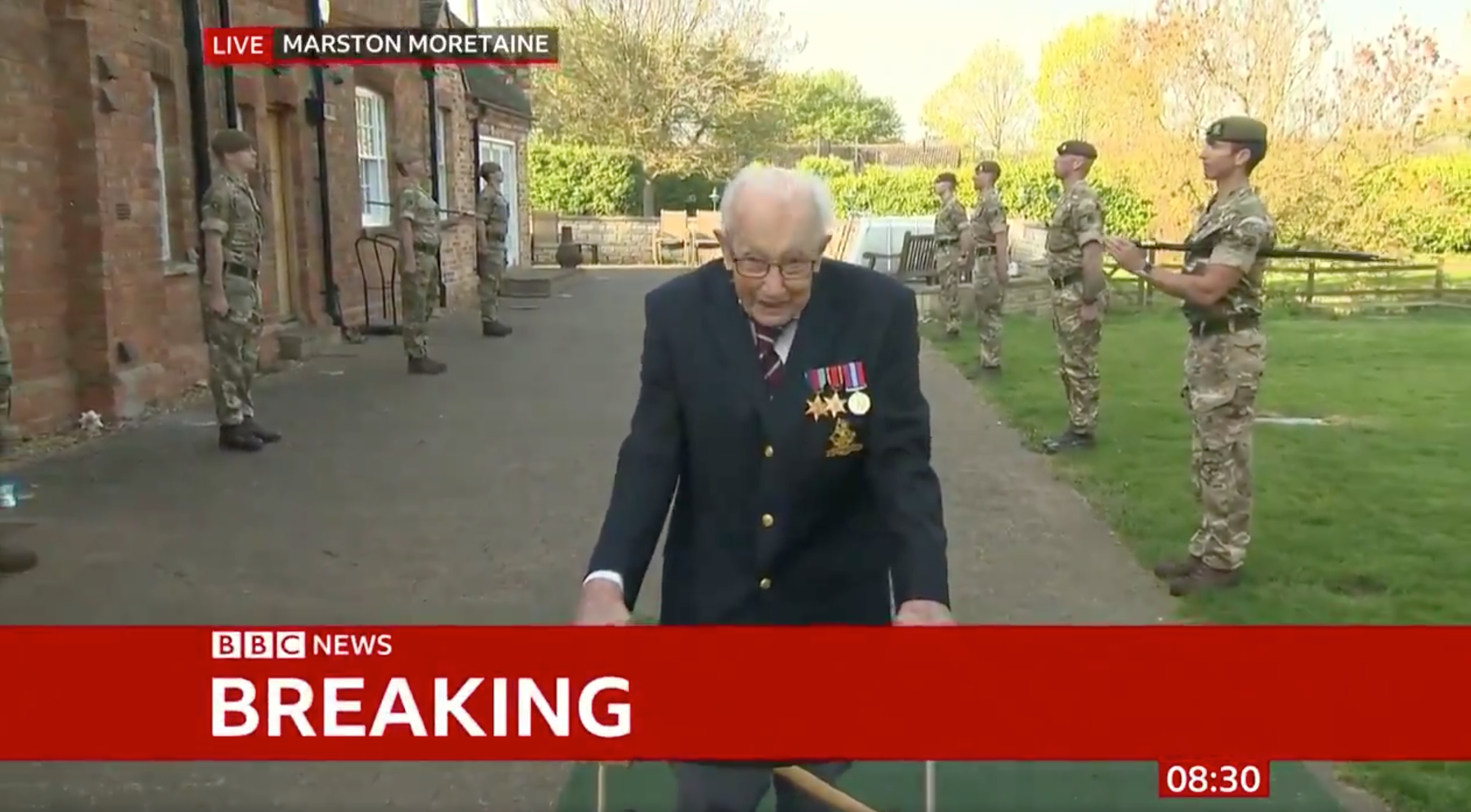 Above: Captain Tom Moore on BBC News completing his 100th lap, which has seen him raise more than £13 million for the NHS.