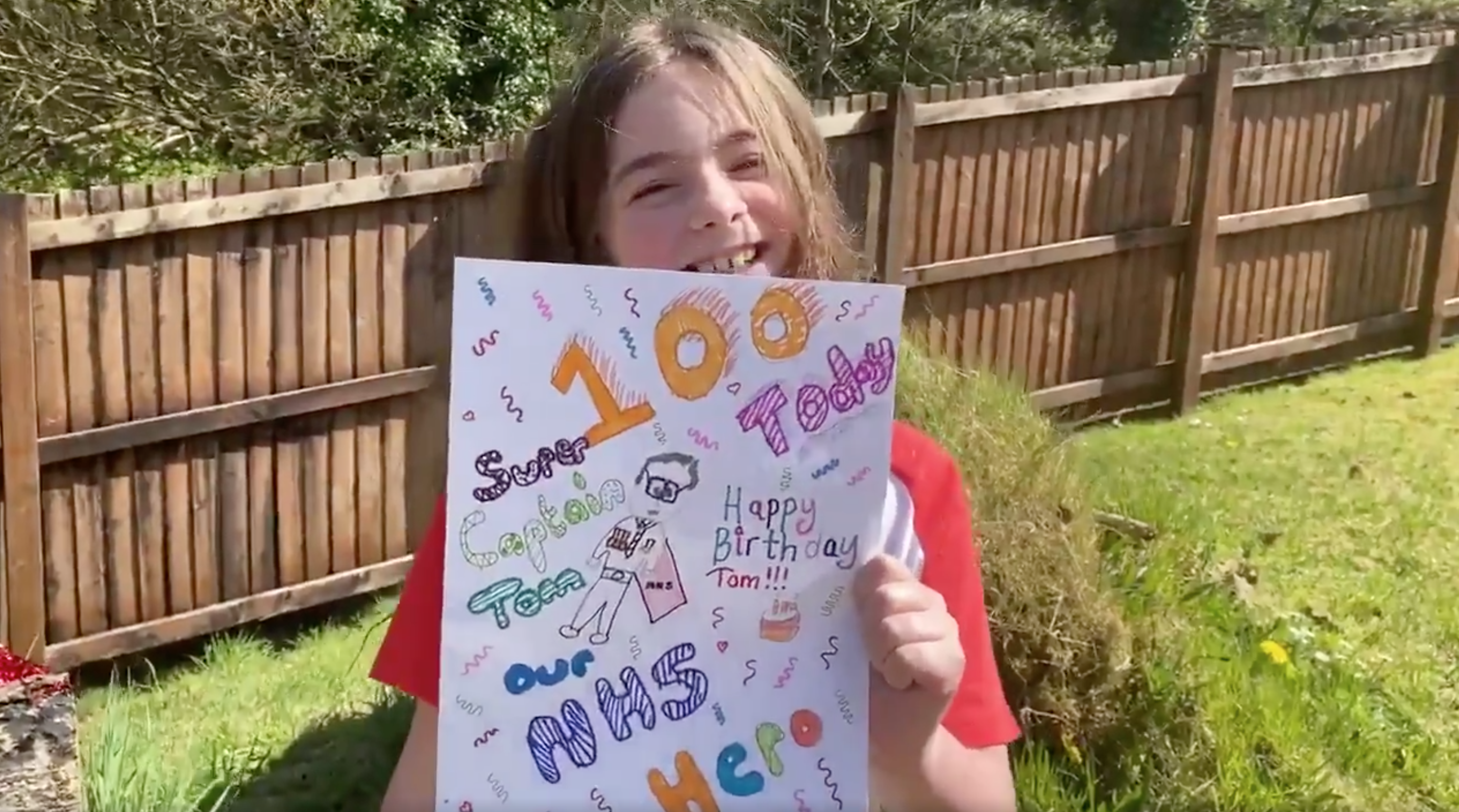 Above: Reegan Davies showing the birthday card she has created for Captain Tom for his imminent 100thbirthday.