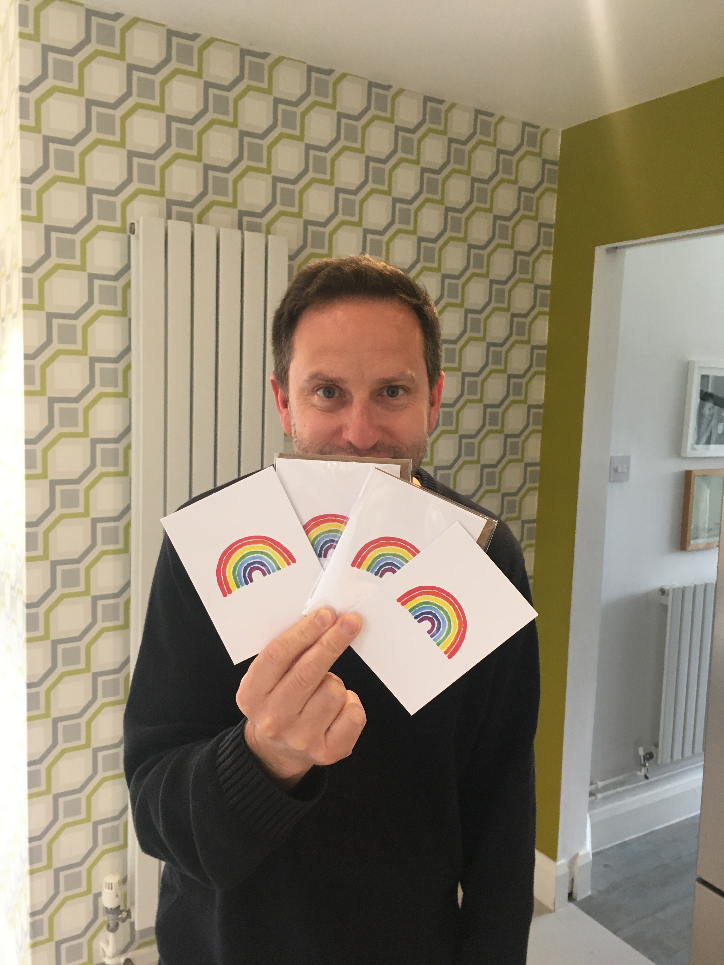 Above: Dominic Early with some of the cards that has been distributed to all neighbours in two streets close to the family home in Canterbury.