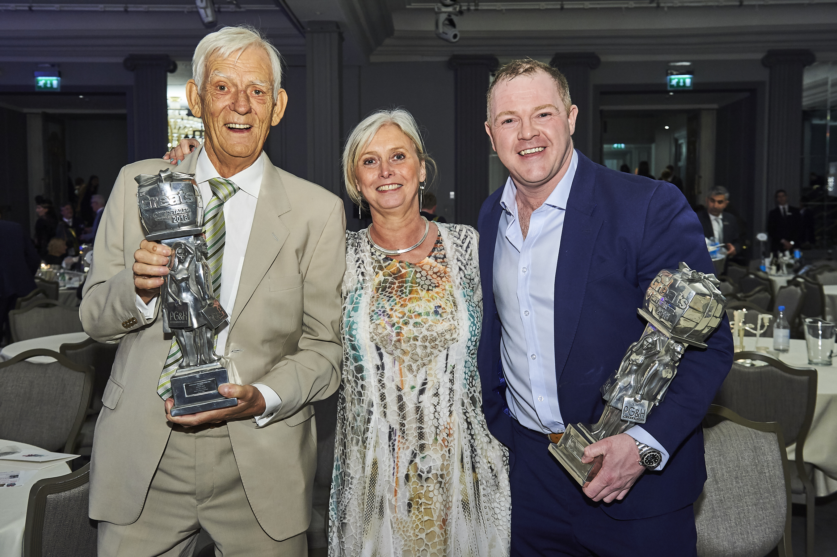 Above: David Robertson (right) with his 2018 Greats (gift retailer trophy) with fellow Scottish indies, Constance and Hamish Wemyss of The Gift in Beauly and their trophy.