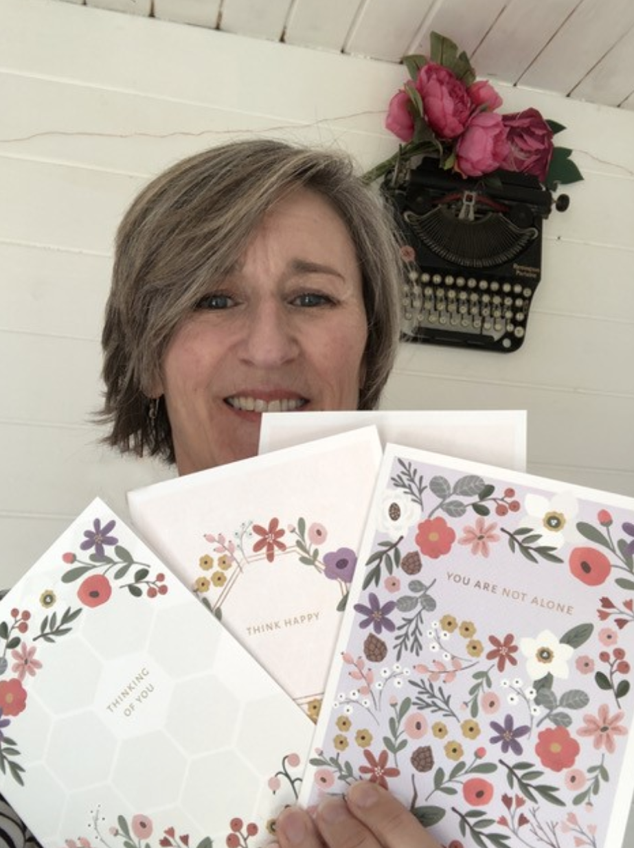 Above: Emma Bryan with some of her Softly Spoken cards.