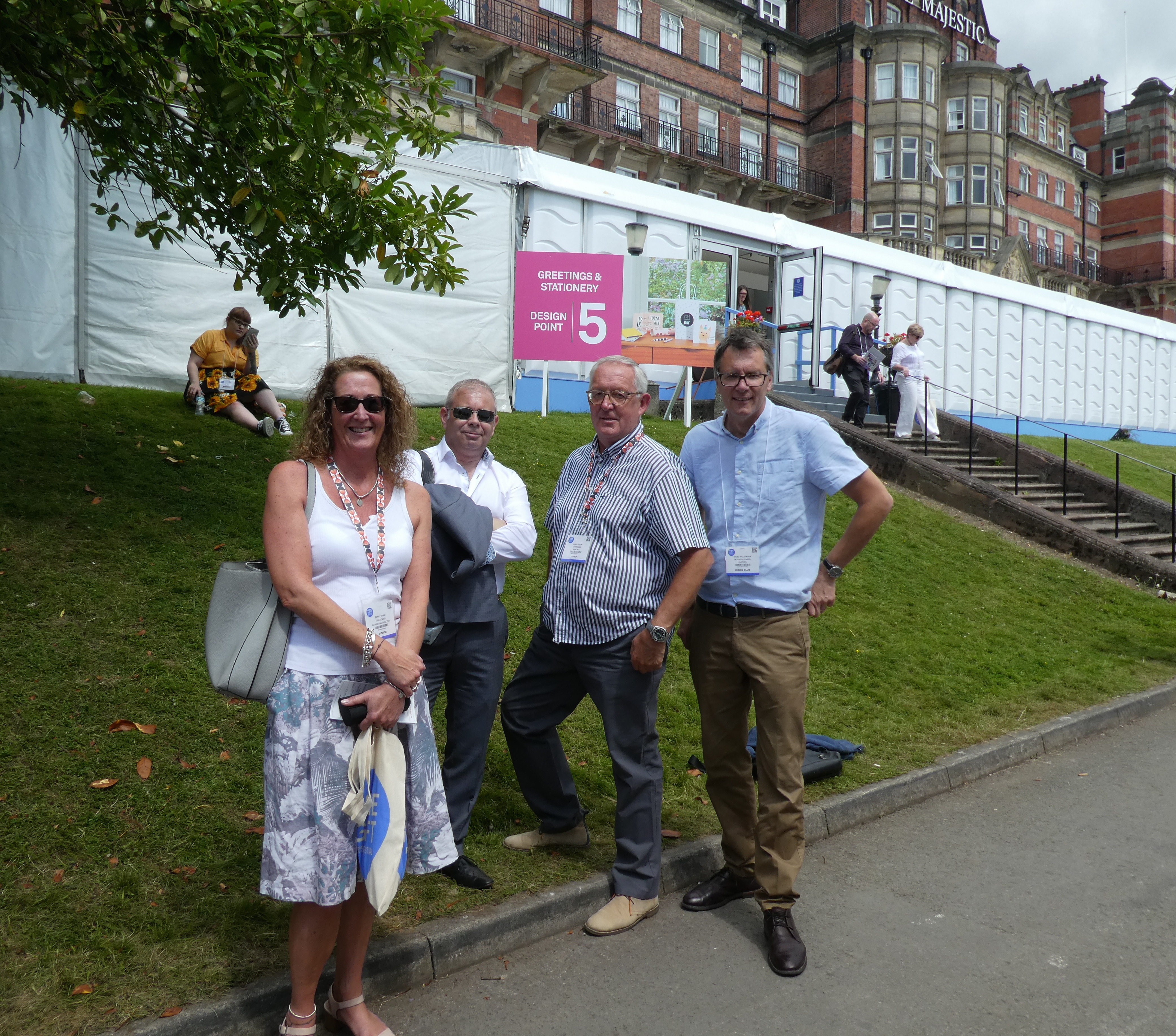 Above: Cardgains' Penny Shaw and Chris Dyson (second right) with House of Cards' Nigel Williamson (far right) and Miles Robinson outside the Greetings & Stationery hall at last year's show.