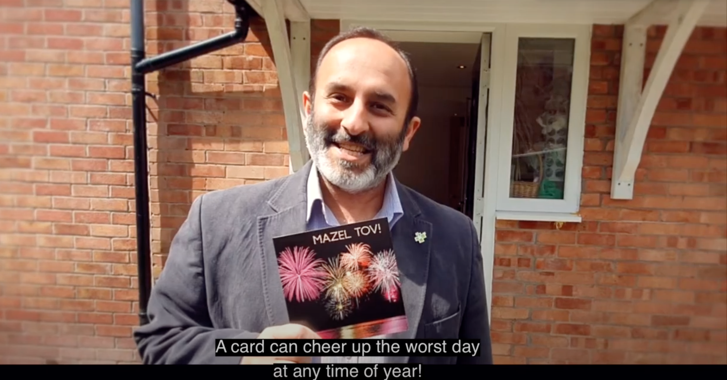 Above: Raj Arora, md of Davora making the point how receiving a card can lift the spirits even on the darkest of days.