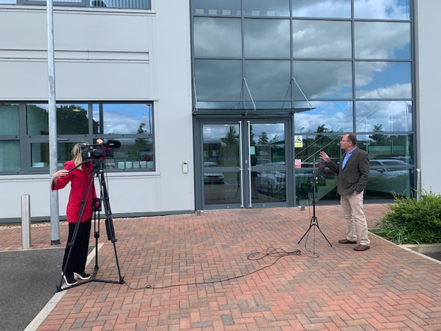 Above: Windles' md Bruce Podmore being filmed by Lauren Hall explaining how its machines are being used to produce two items that are essential to the current 'war effort' – greeting cards and PPE.