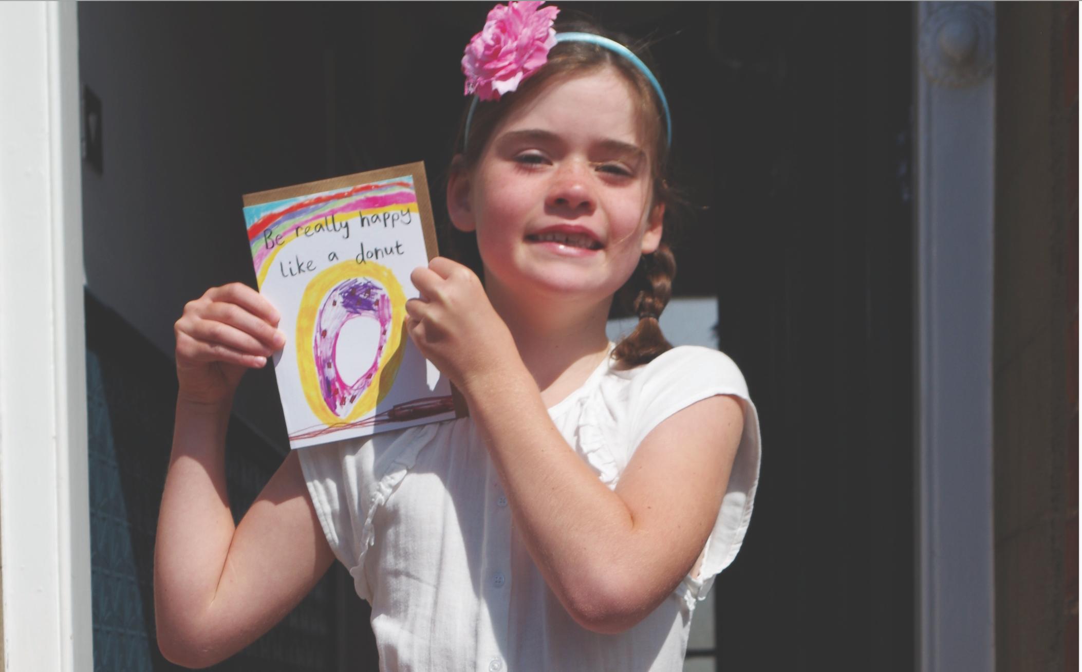 Above: Six-year old Vivi Caplin with her happy doughnut design.