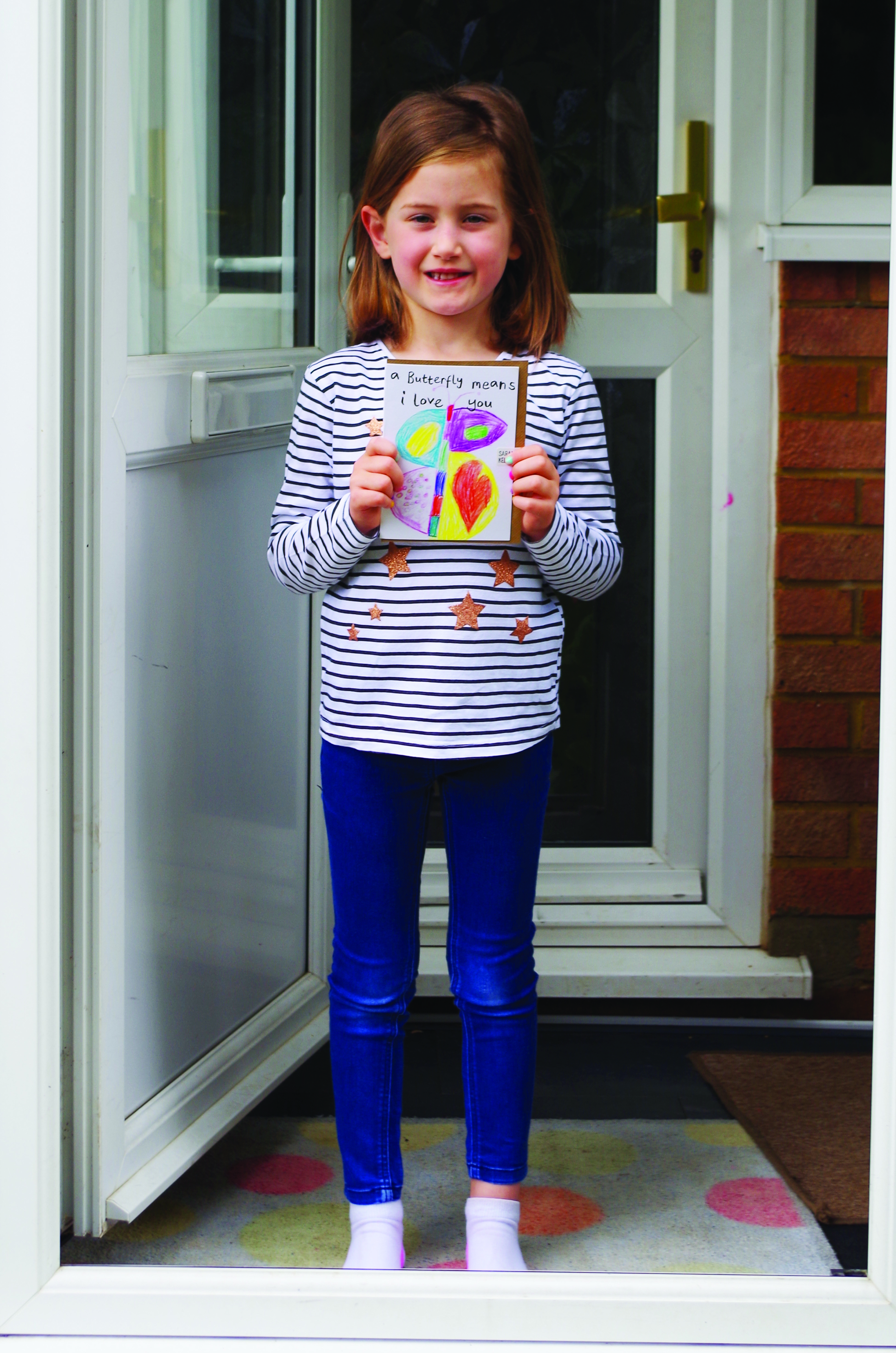 Above: Thea Cook, aged six with her butterfly design.