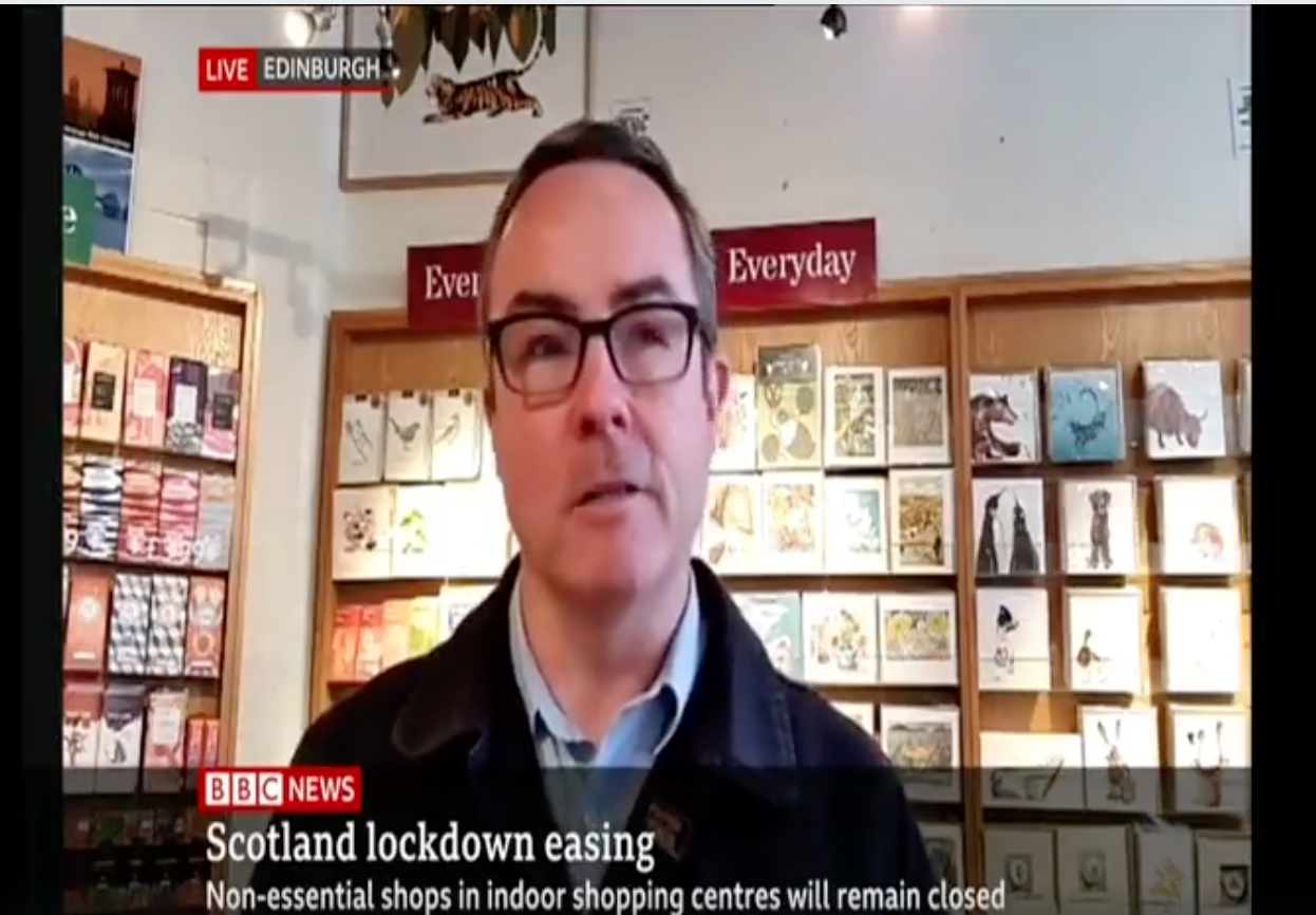 Above: Michael Apter, owner of Paper Tiger (two shops in Edinburgh), speaking live on BBC News yesterday, the first day non-essential shops (with doors that open to the streets) were allowed to re-open in Scotland as lockdown eases.