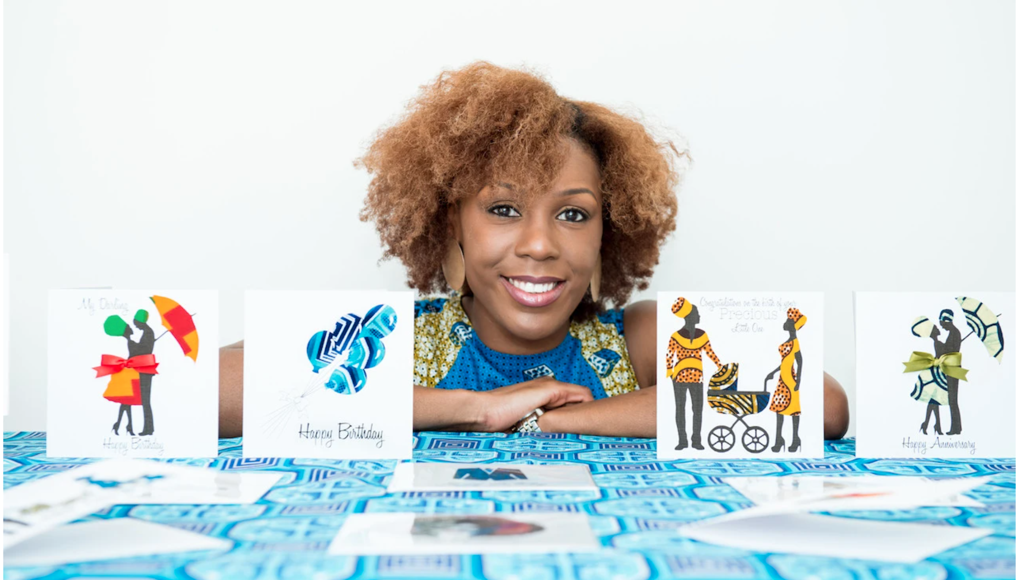 Above: Georgina Fihosy right with some of her cards at the beginning of her greeting card journey. She includes many great blog posts on her website https://afrotouch.design/)