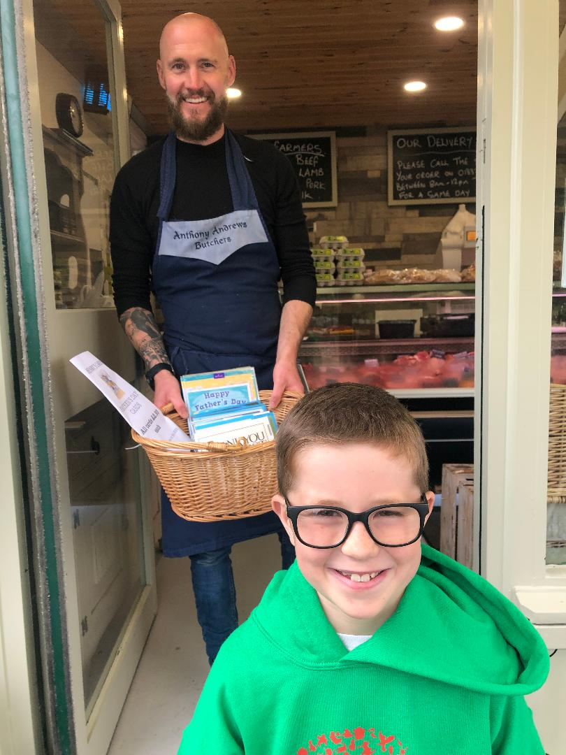Above: Henry Rees with the local butcher he has done a deal with to sell Father's Day cards.
