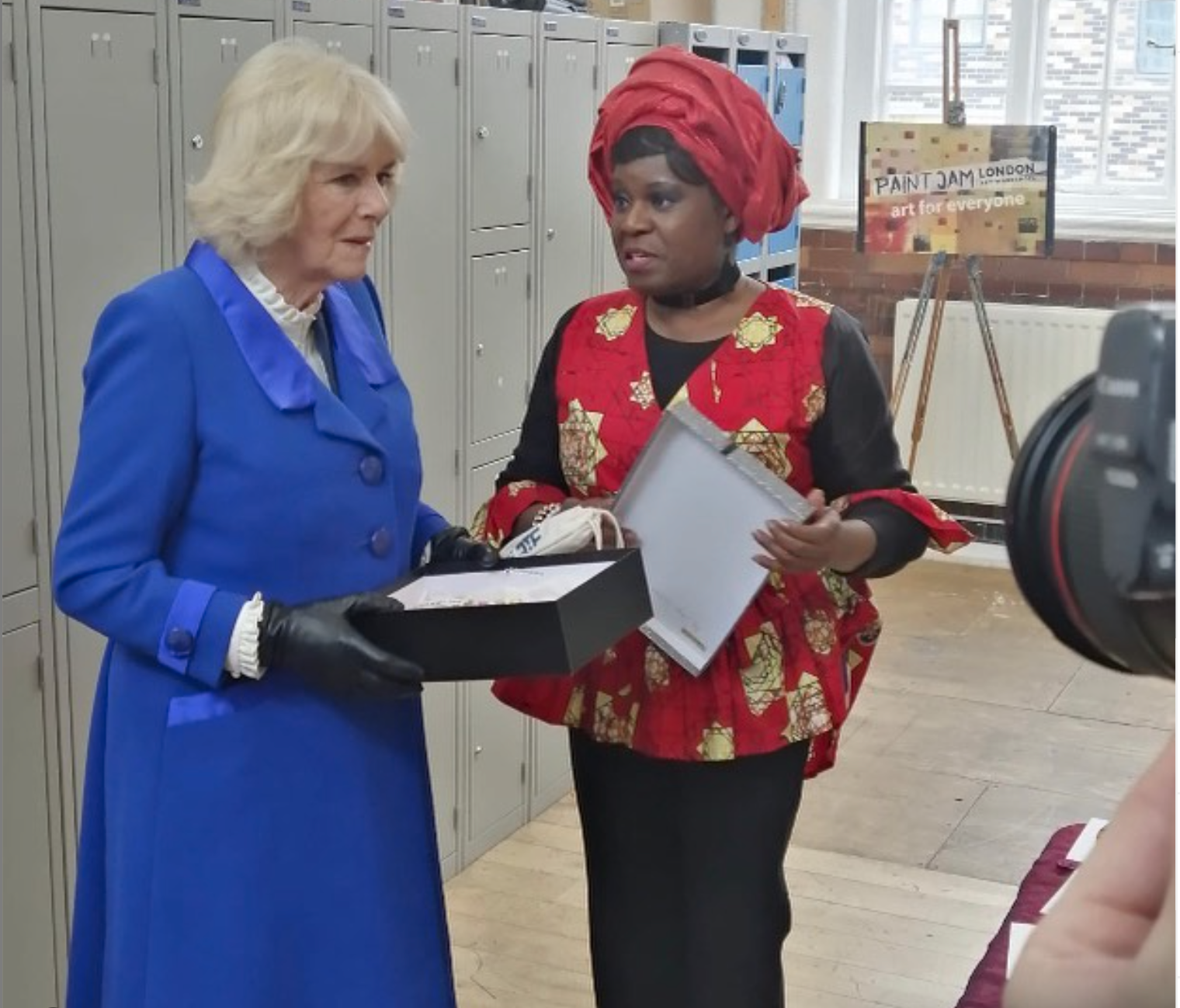 Above: Dayo Williams, founder of Handmade By Dayo card company with the Duchess of Cornwall earlier this year explaining about her business, which creates cards featuring 19 different skin tones.