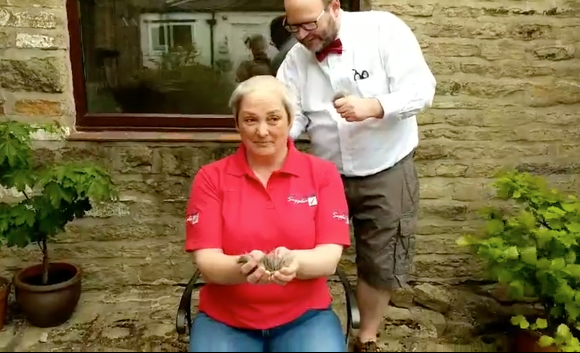 Above: Sarah Laker, owner of Marple Stationery Supplies braving the shave from her husband, live on Facebook video, to raise money for Mellor Country House, a much-loved local charity.