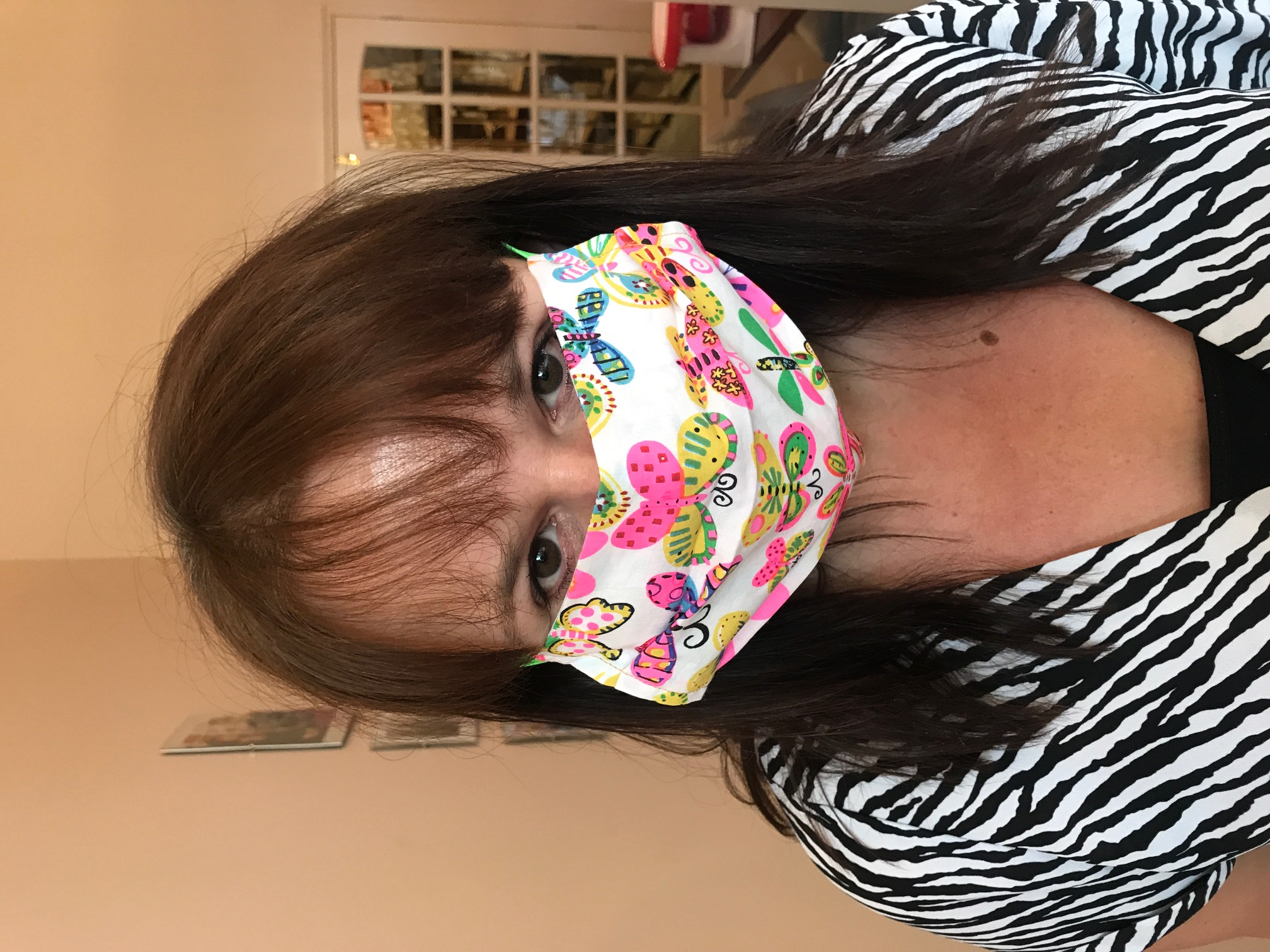 Above: Claire Williams, co-owner of Paper Salad in a mask made out of fabric printed with the publisher's designs.