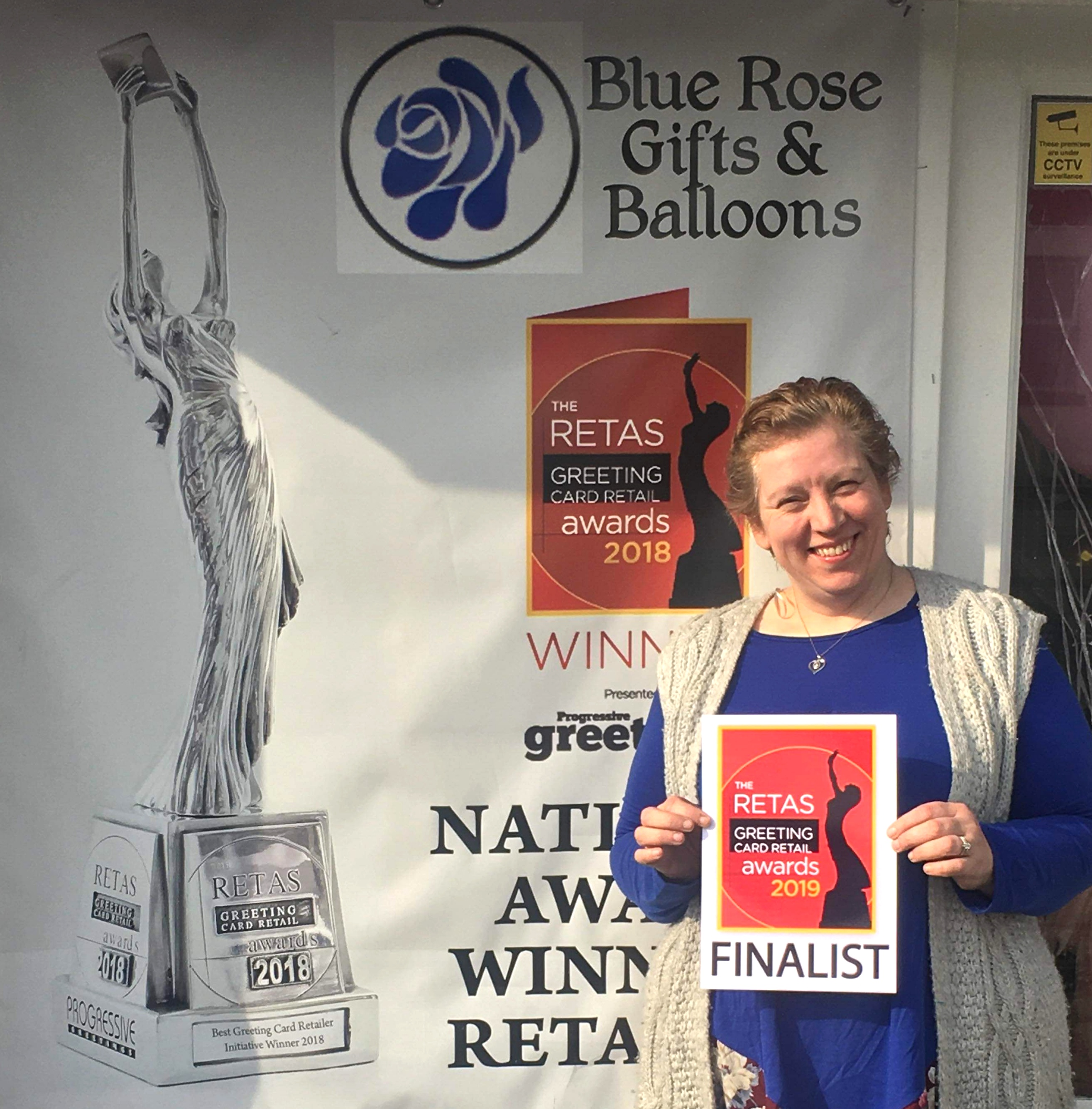 Above: Beverley in front of her shop with one of the many Retas nominations she has received over the years.