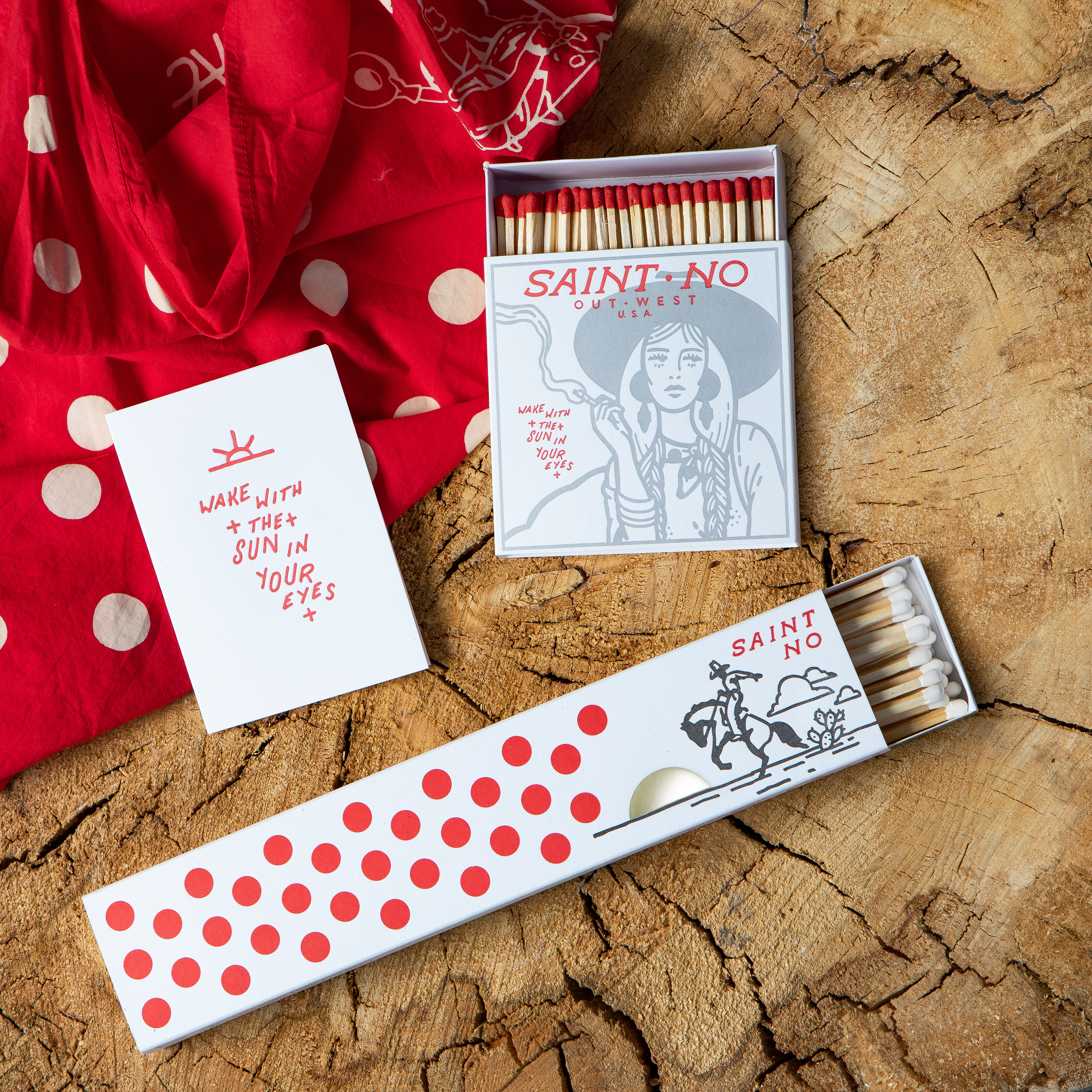 Above: Some Saint No designs on letterpressed cards and matches from Archivist Gallery.