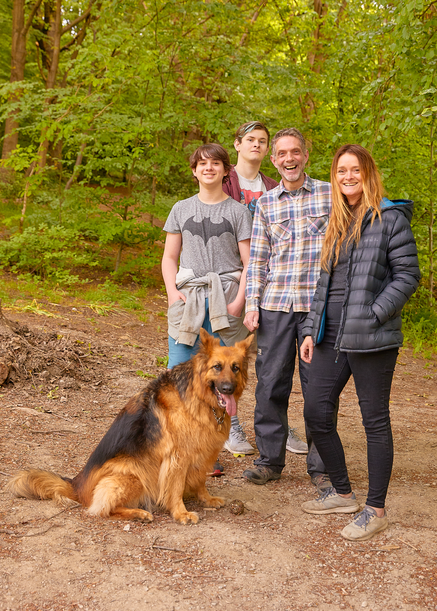 Above: Photo of the Jones-Blackett family that was taken by Willie Runte a dog-walking professional photographer friend as part of his 'dog walkers during lockdown' project.