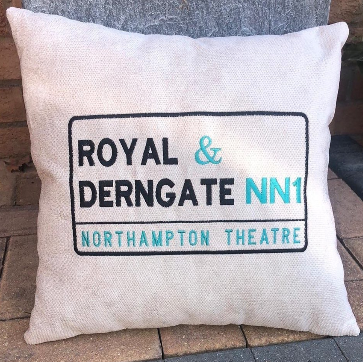 Above: The limited edition cushion the sales of which are raising funds for Northampton's Royal & Derngate theatre.