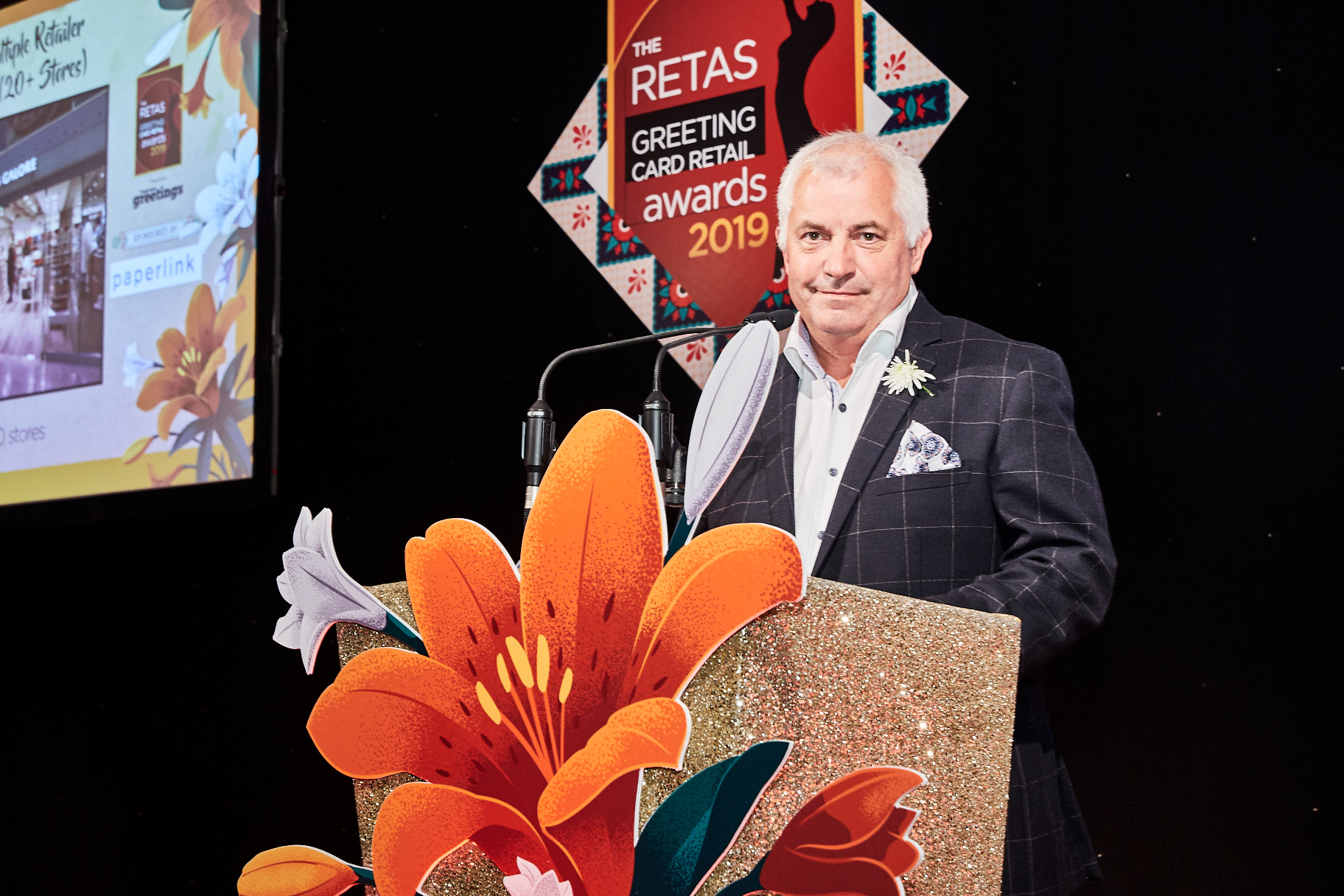 Above: Bill Greeno on stage at The Retas awards, of which Paperlink is a sponsor.