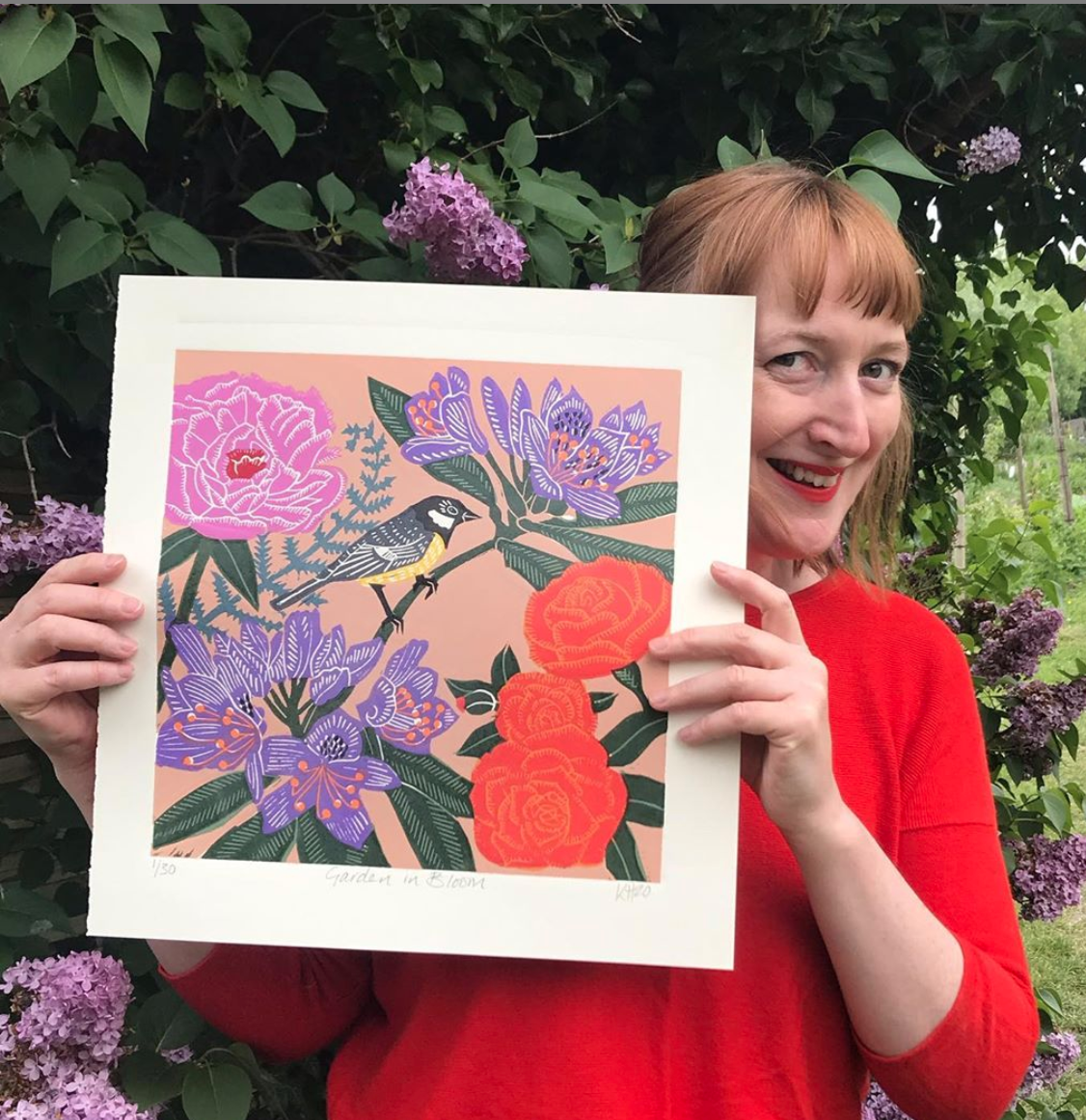 Above: Printmaker Kate Heiss with her art that appears in The Art File's Nature Trail collection.