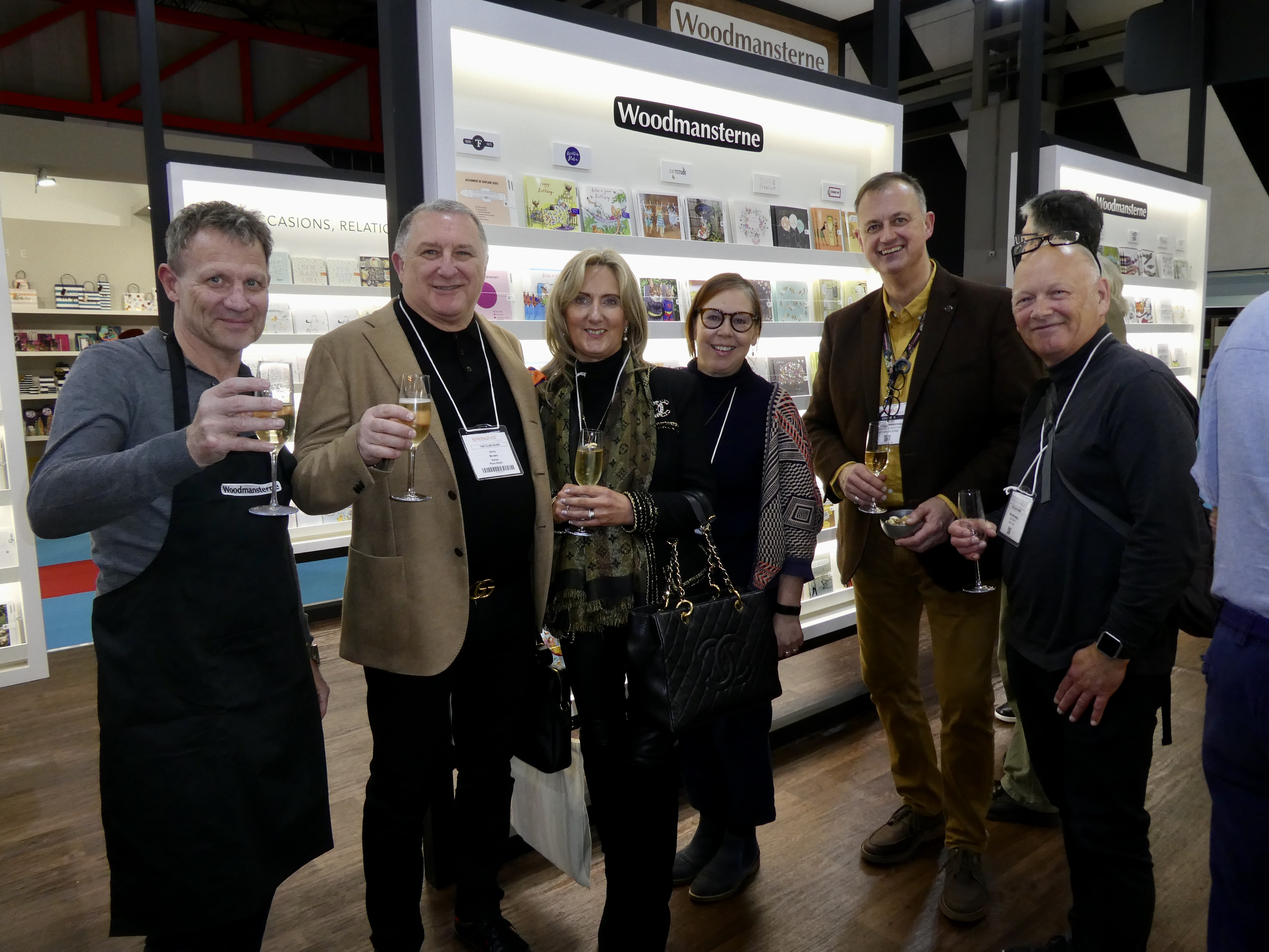 Above: (Left-right) Andy Paterson (Woodmansterne); Jerry and Debbie Brown (First Class Greetings), Sarah Green (Wave/High Tide), Paul Woodmansterne (Woodmansterne) and Guy Mitchelle (Wave/High Tide) on Woodmansterne's stand at this year's Spring Fair.