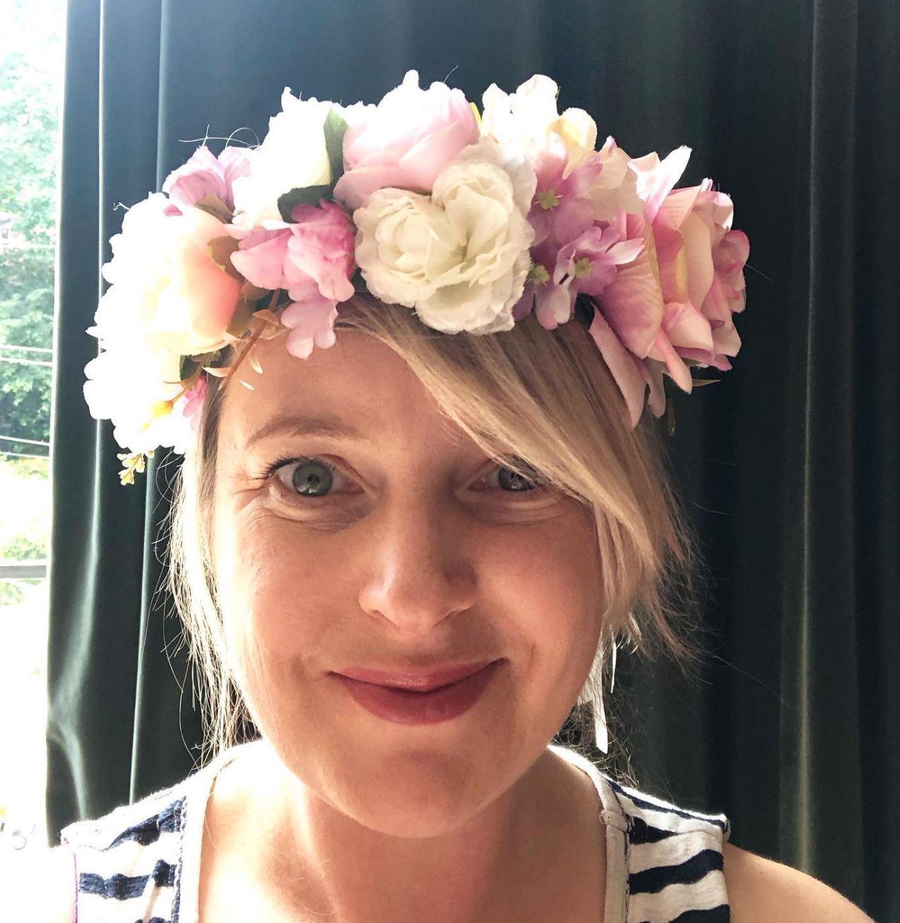 Above: Lucy Sharp modelling one of the floral headpieces from the Talking Tables range.