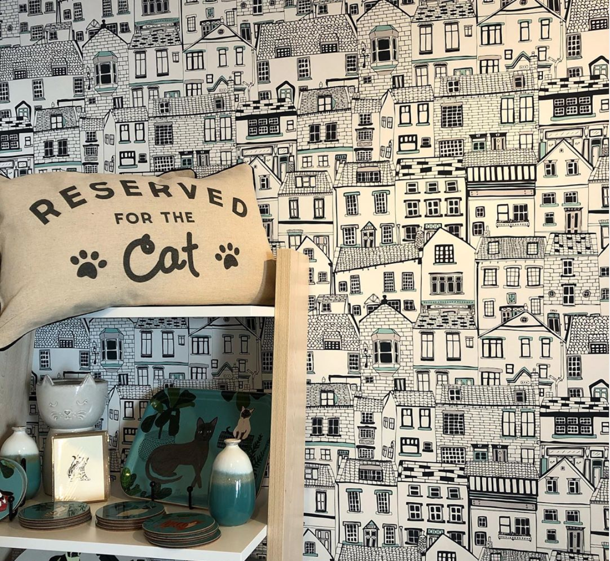 Above: Jess' Coastal Cottages wallpaper adorns one of the walls in the shop.