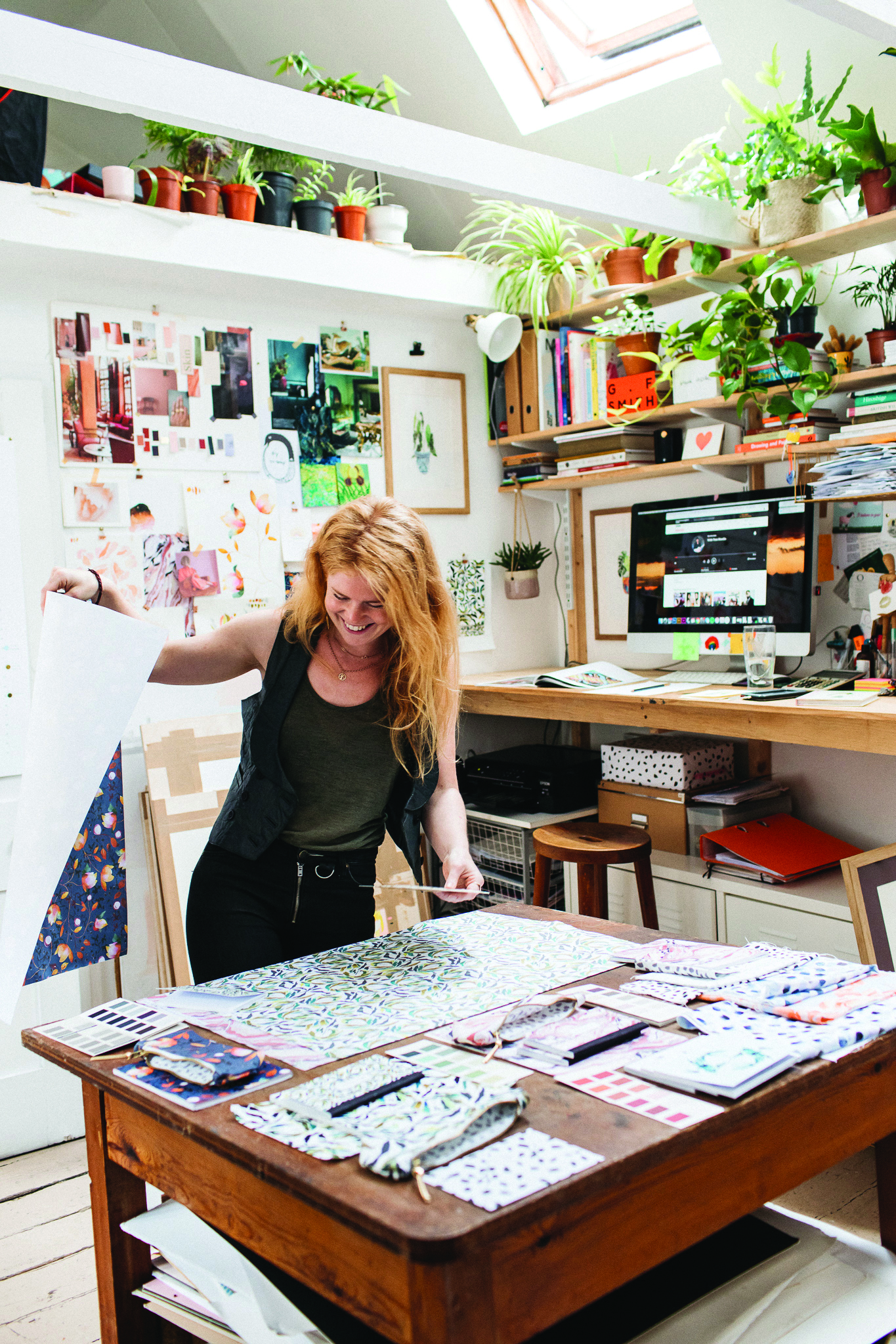 Above: Liz in her studio surrounded by her verdant and vibrant house plants.