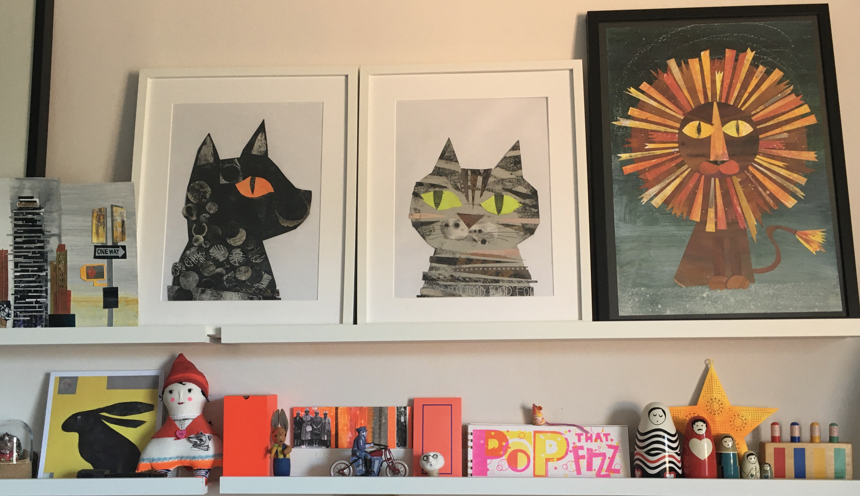 Above: Reggie's new studio wall, which features a mix of Reggie's own collage work, memorabilia and others' splendid work.