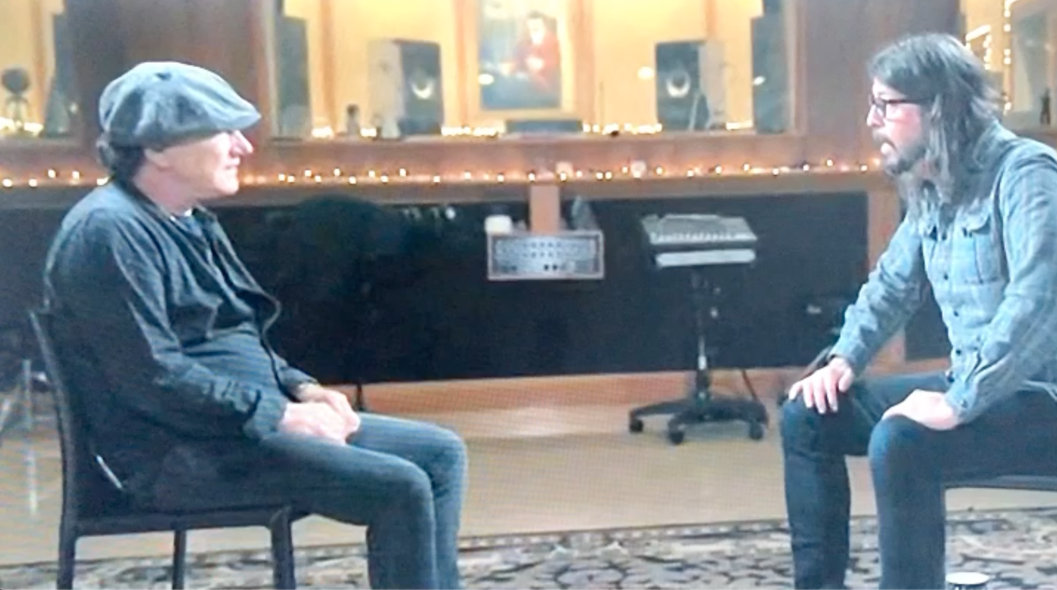 "Above: David Grohl (right) emotionally shares how one card really was ""the beginning of the Foo Fighters""."