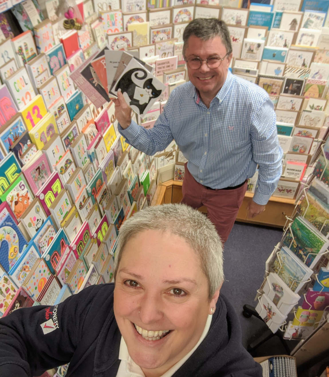Above: Sarah Laker with agent Nigel Willcock inside her Marple store.