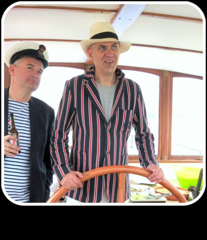 Above: Master of his own ship! David with PG's Ian Hyder at a party on his boat.