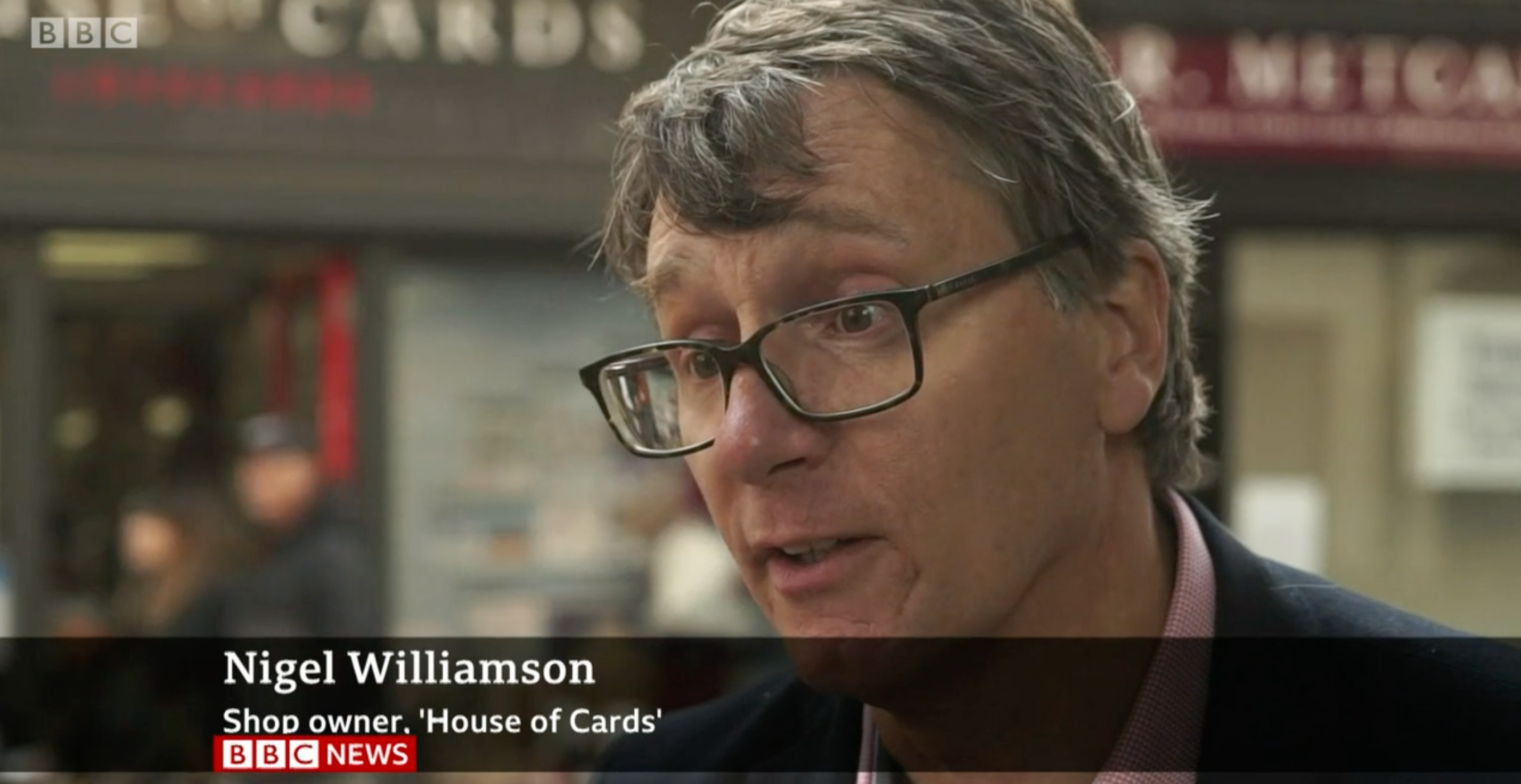 """Above: Nigel Williamson, co-owner of House of Cards greeting card retail group appeared on BBC's 6 o'clock news on Tuesday with the plea: """"We need to stay open."""""""