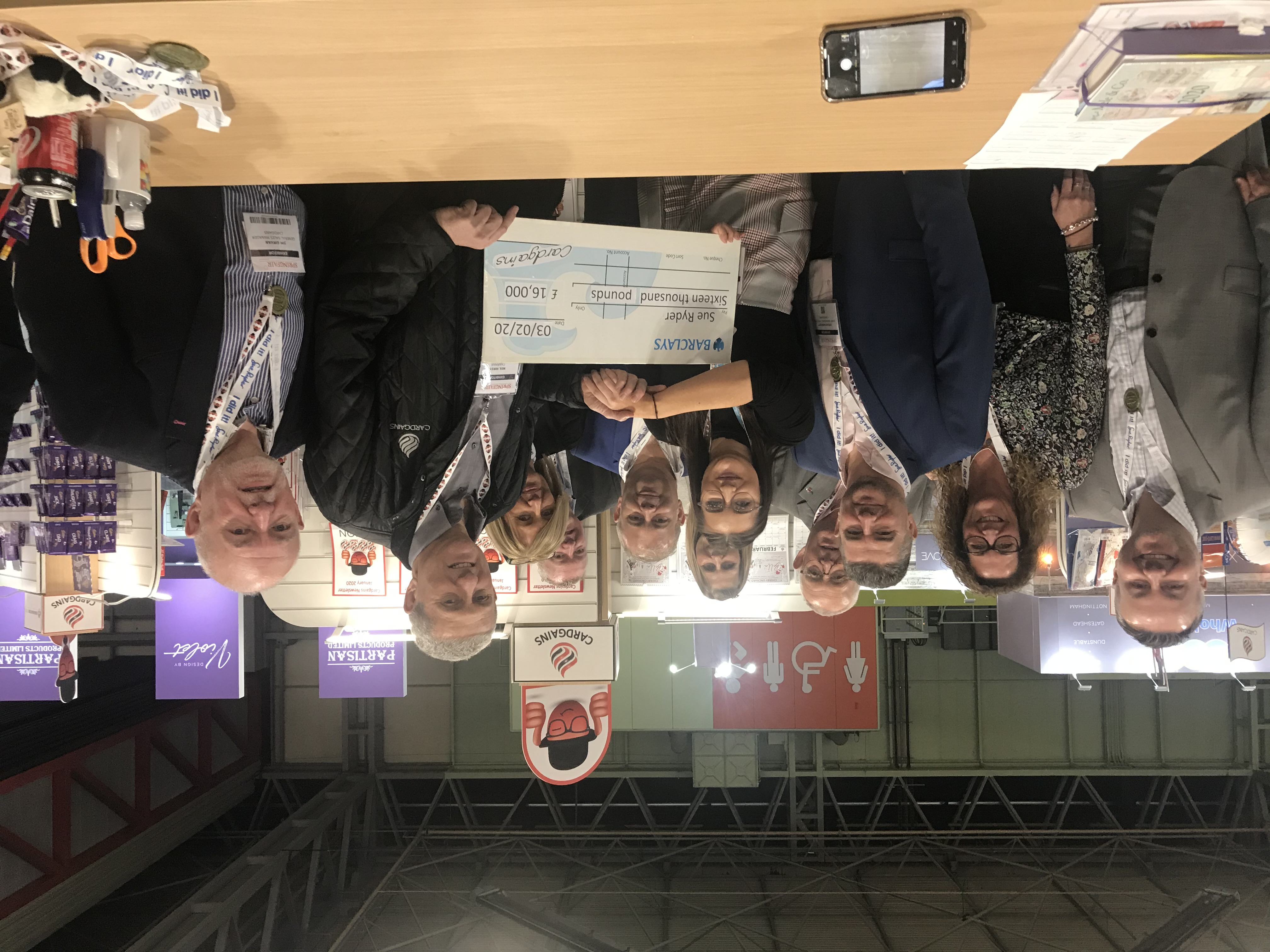 Above: The Cardgains team, members and suppliers on the buying group's 'Village' stand at Spring Fair in February presenting a cheque to Sue Ryder, as a result of its charity fundraising activity in 2019.