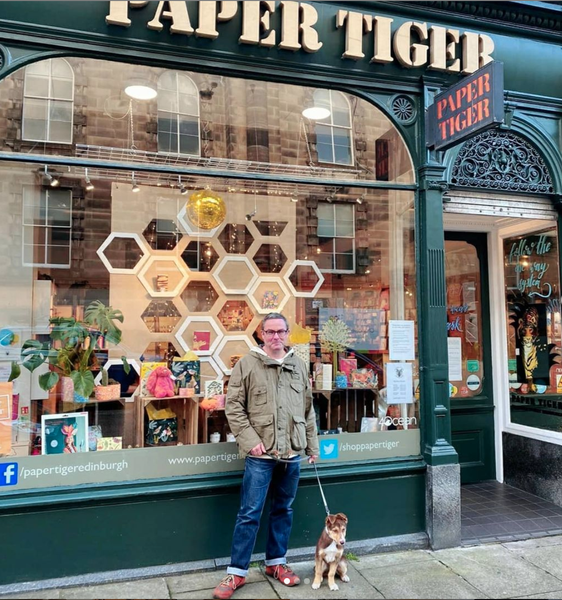 Above: Michael Apter outside one of the Paper Tiger shops with his puppy, Clementine.