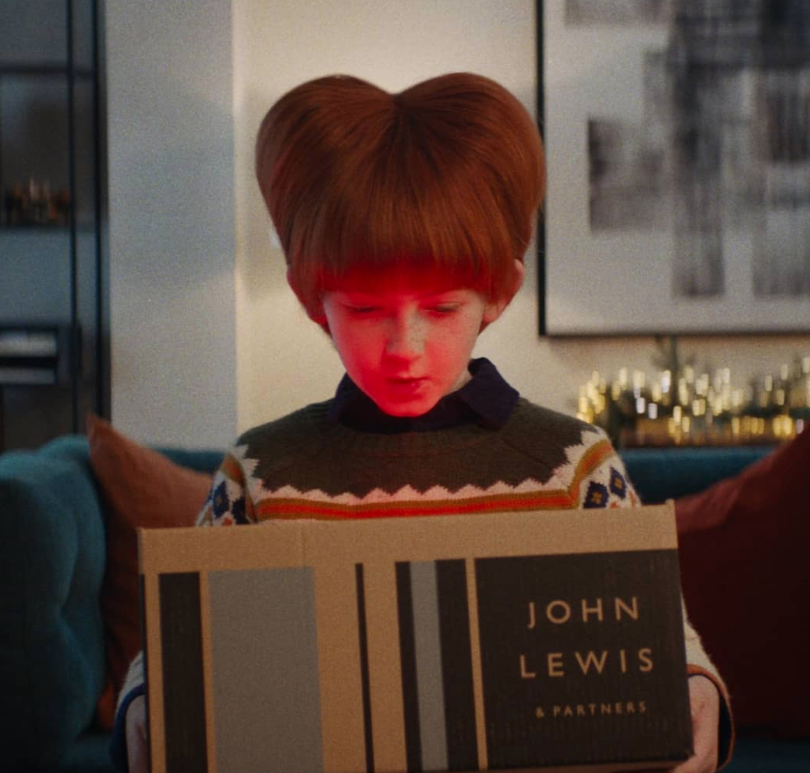 Above: John Lewis' Give a Little Love theme for this Christmas has chimed with the psyche of the nation.