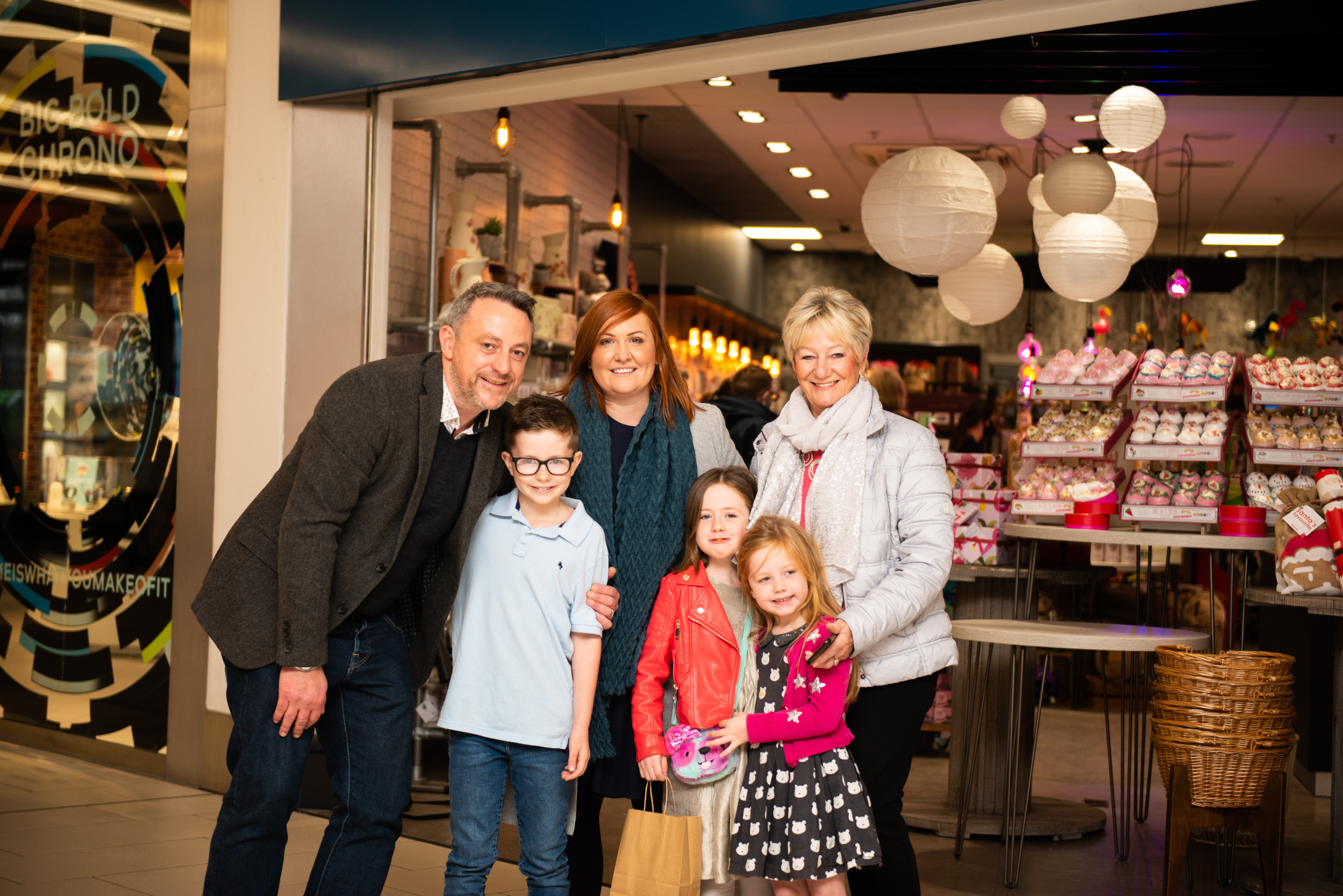 Above: (Left-right) Mark Rees with his son Henry, wife Katy, daughters Lucy and Alice and mum Ann outside the new shop.