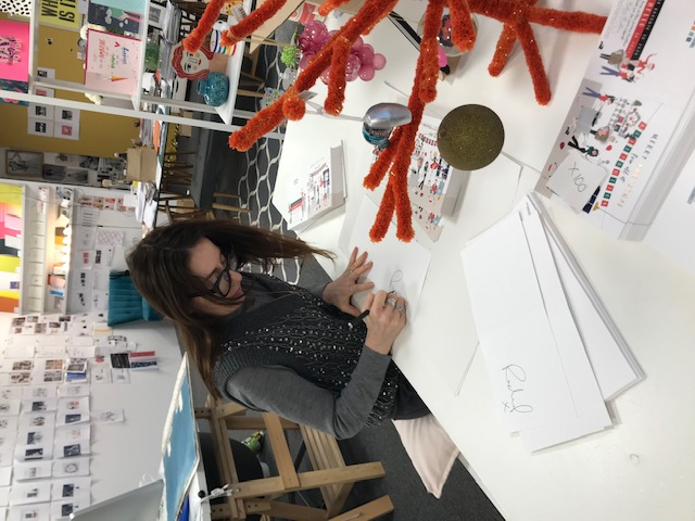 Above: Belly Button's Rachel Hare writing her Christmas cards.