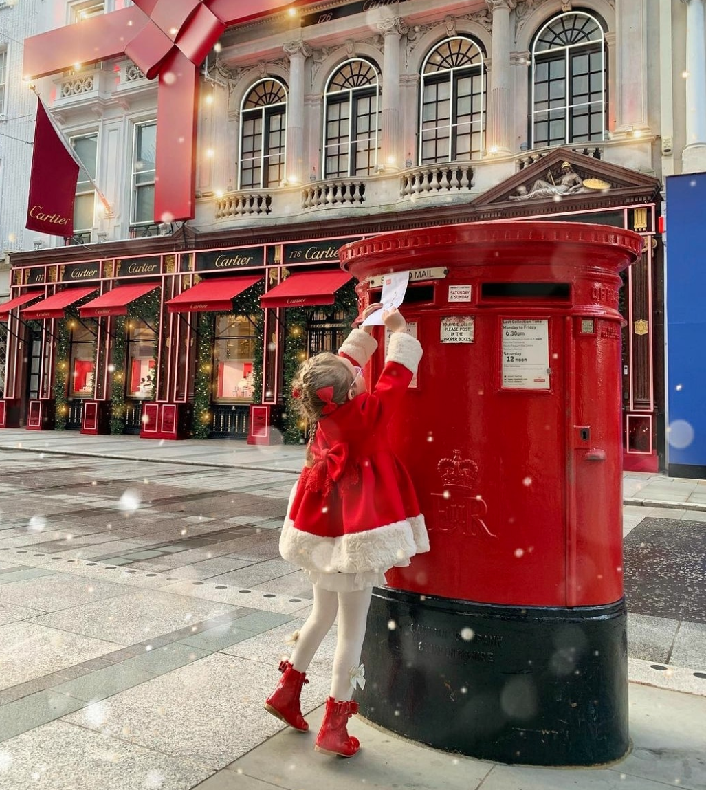 Above: Many members of the UK public are expected to send more Christmas cards this year.