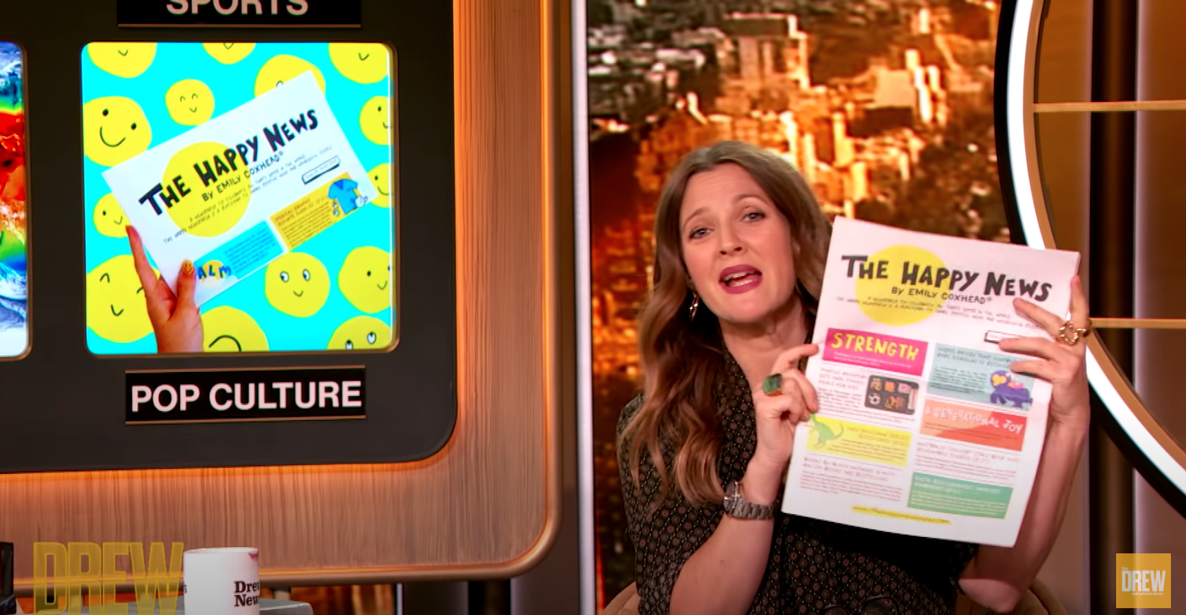 Above: Drew Barrymore extoling the virtues of The Happy News on a recent episode of The Drew Barrymore Show.
