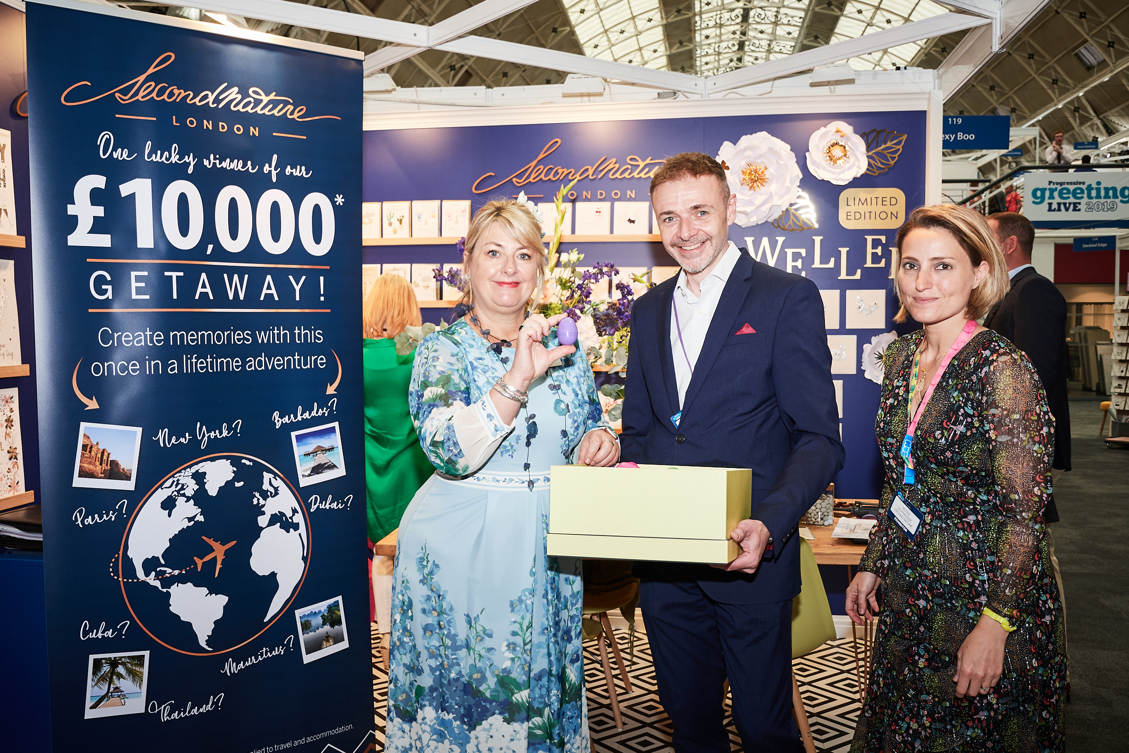 Above: Chris Bryan with Second Nature co-general manager, Nicole Schragger (right) at the last PG Live at which the publisher gave away a £10,000 holiday! PG's Jakki Brown (left) picked the winner.