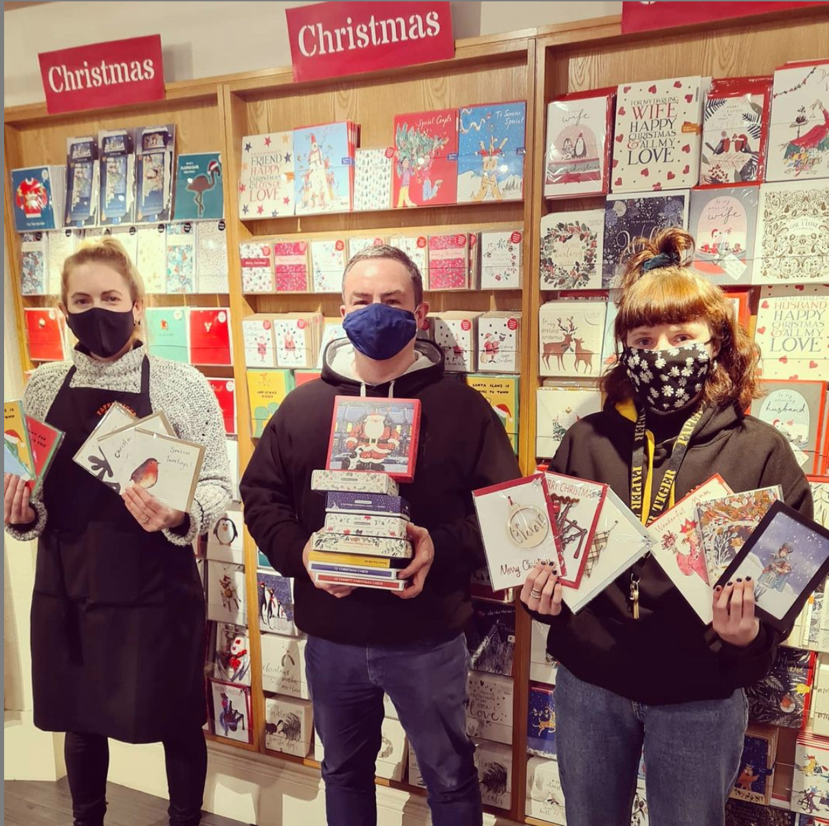 Above: Paper Tiger's Michael Apter and two colleagues with a taster of the Christmas cards it offered.