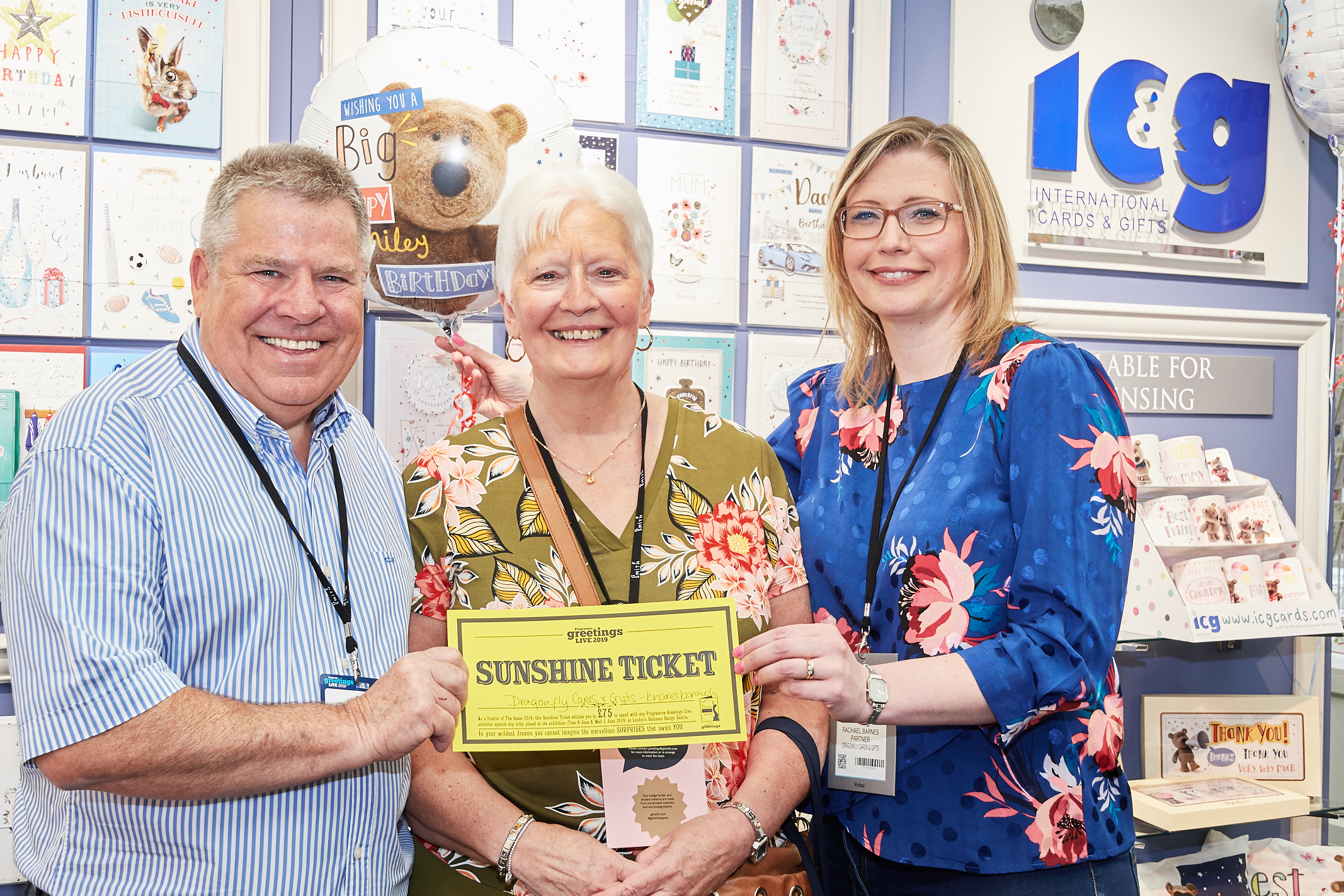 Above: Three rays of sunshine – Tony Roberts with Dragonfly Cards and Gifts' Rachael Barnes (right) and Rita Knibbs at PG Live.