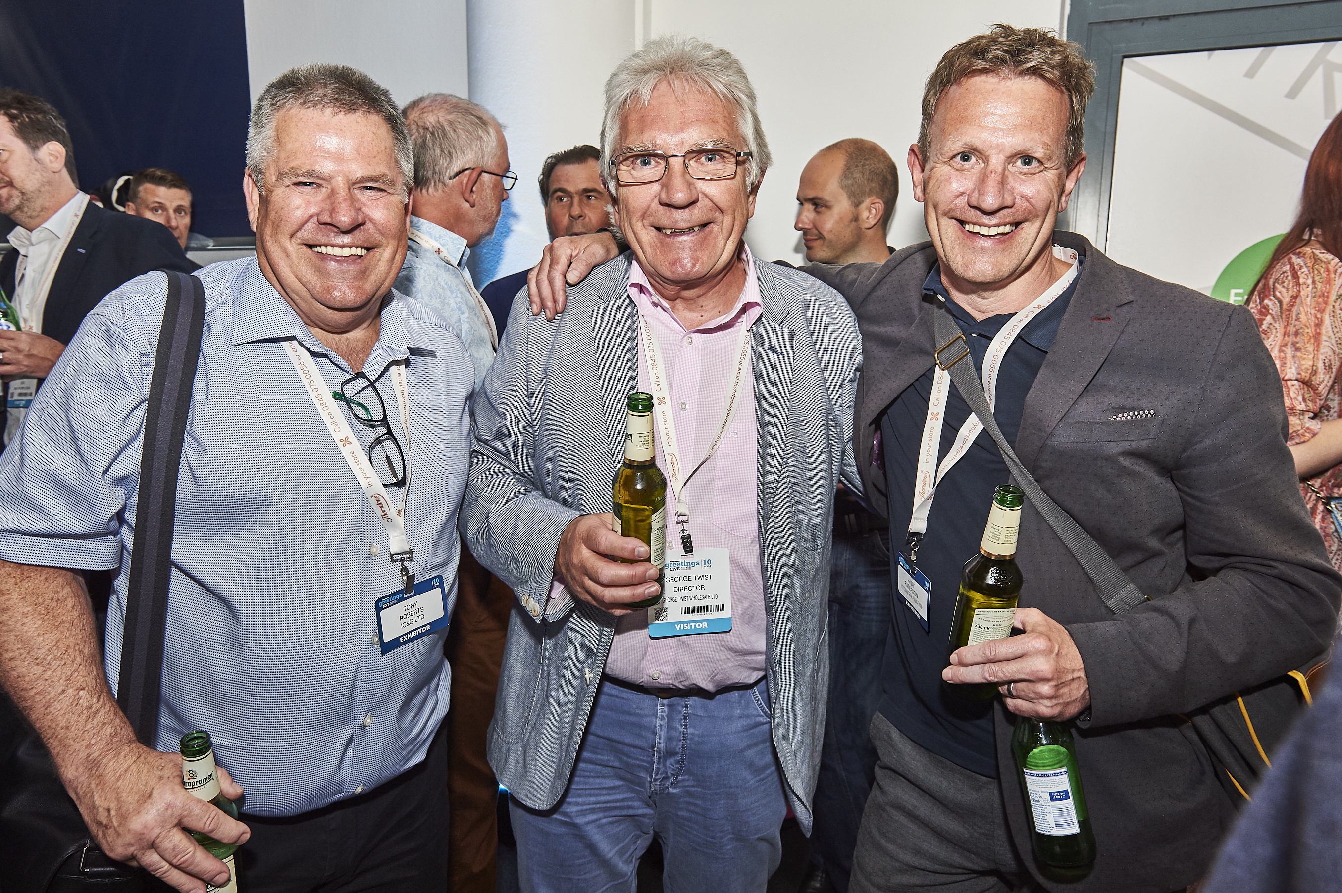 Above: Tony (left) with former Gibsons colleague (right) Andy Paterson (now sales director of Woodmansterne) and customer George Twist, managing director of Gee Tees, at the PG Live opening night party.