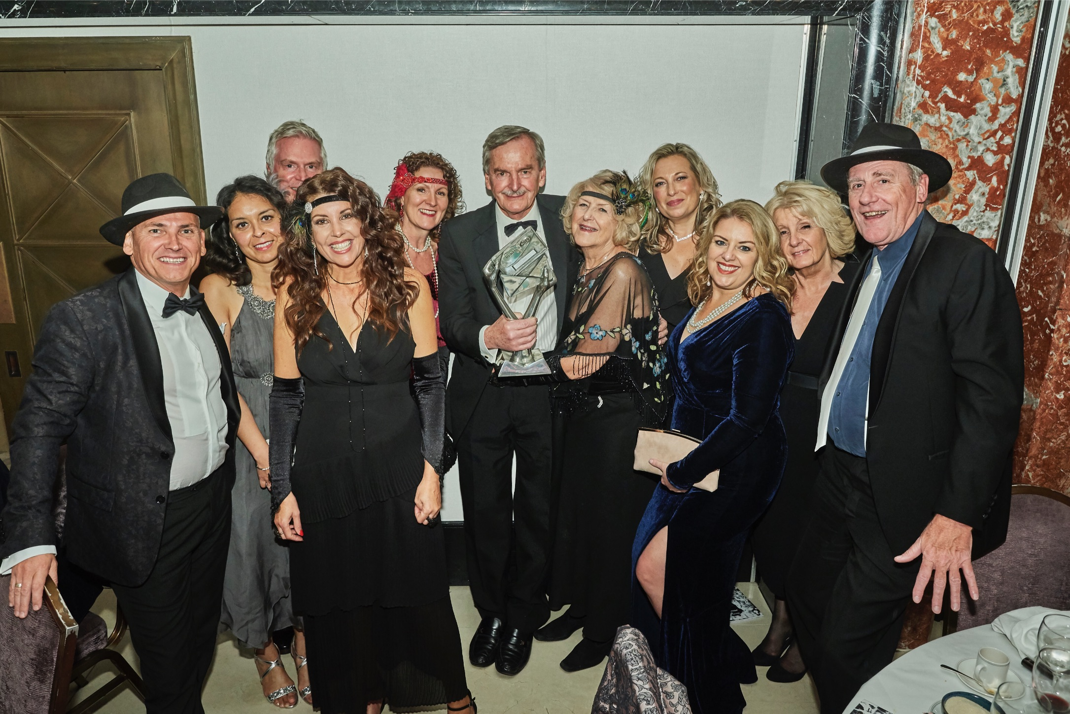 Above: Simon and Janet with many of the Simon Elvin team at The Henries in 2019 at which Simon was presented with a special Outstanding Achievement award.