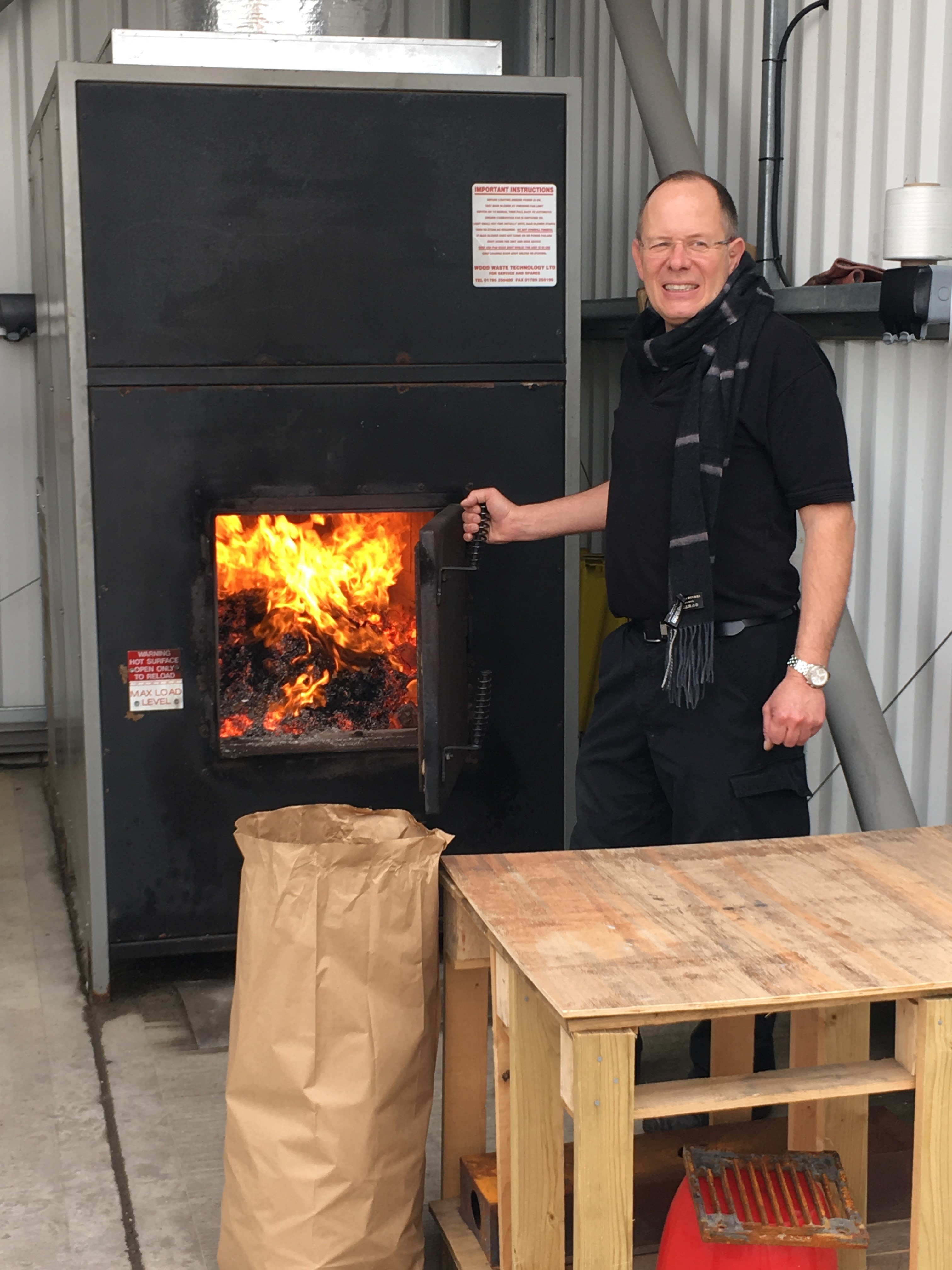 Above: Bruce Podmore, md of Windles at the furnace which uses recycled palettes.