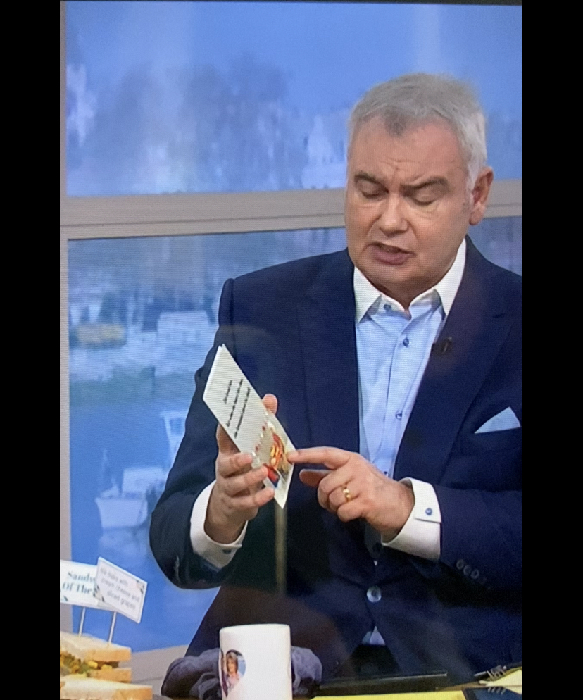 Above: Eamonn Holmes showing the Jeffrey & Janice card on air.