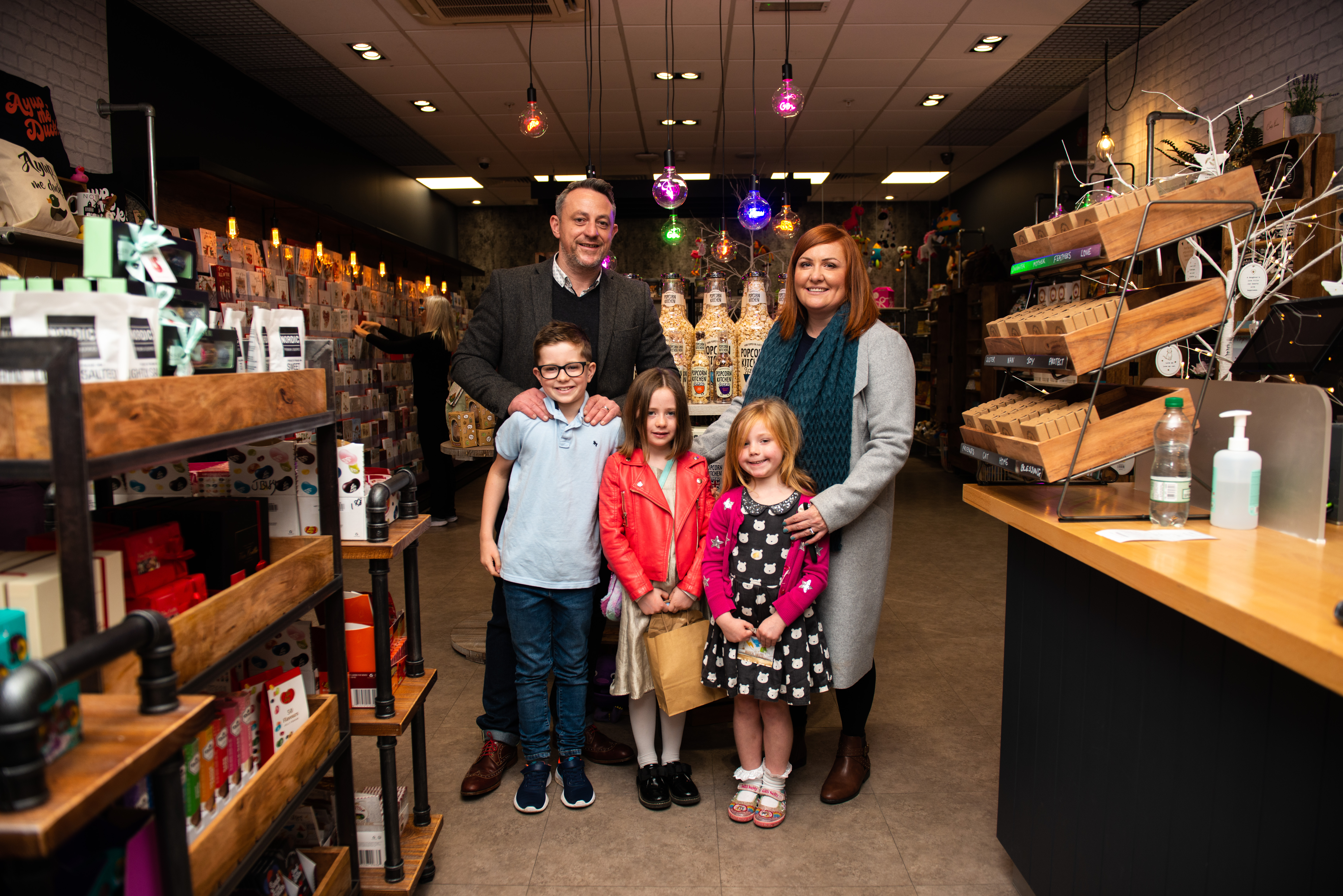 Above: Mark Rees and his wife Katy with their children Henry, Lucy and Alice inside the Henry & Co shop in Nottingham.