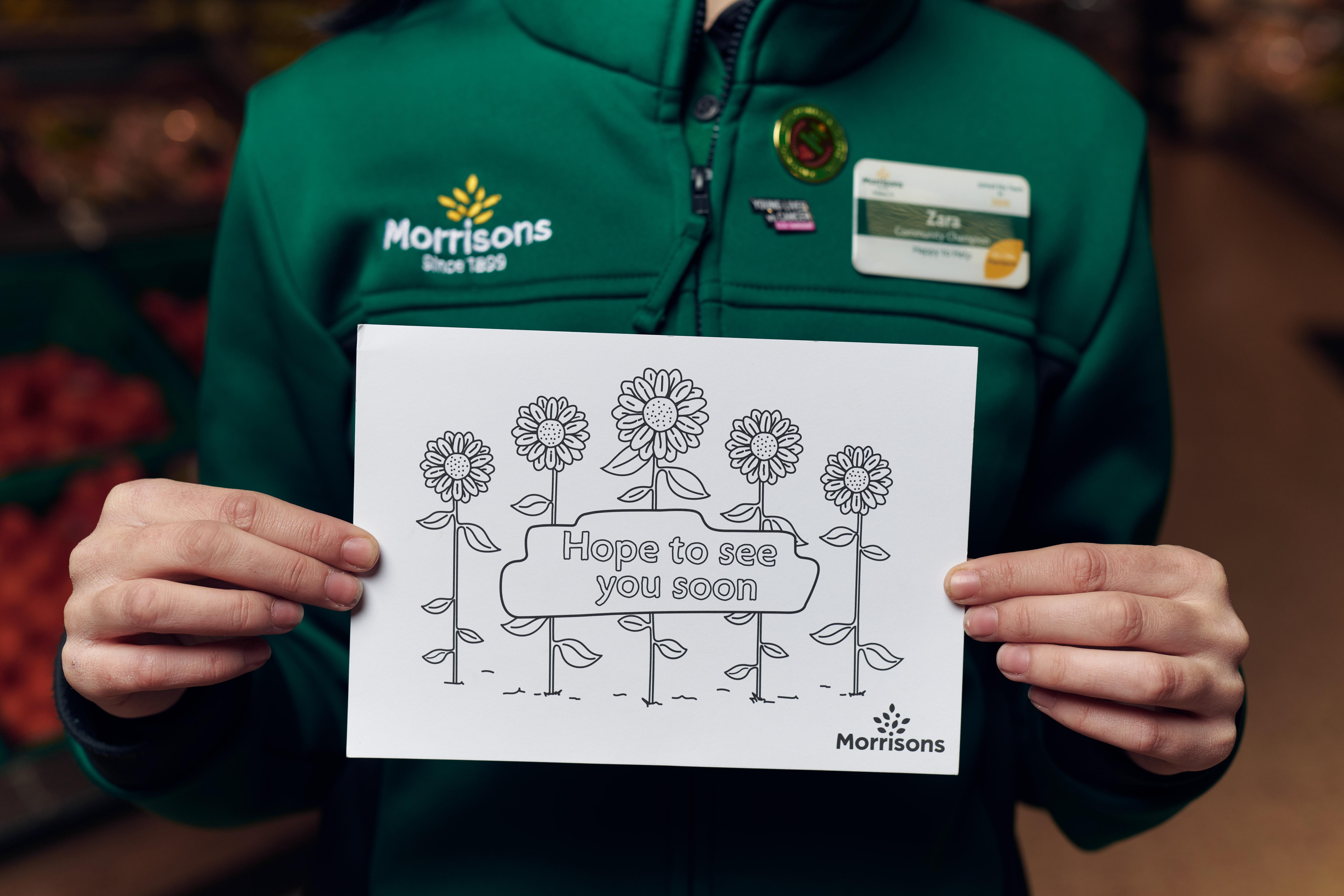Above: The free postcards are making their way to recipients in a number of ways from employees' children, schools, care homes and the supermarket's home delivery service.